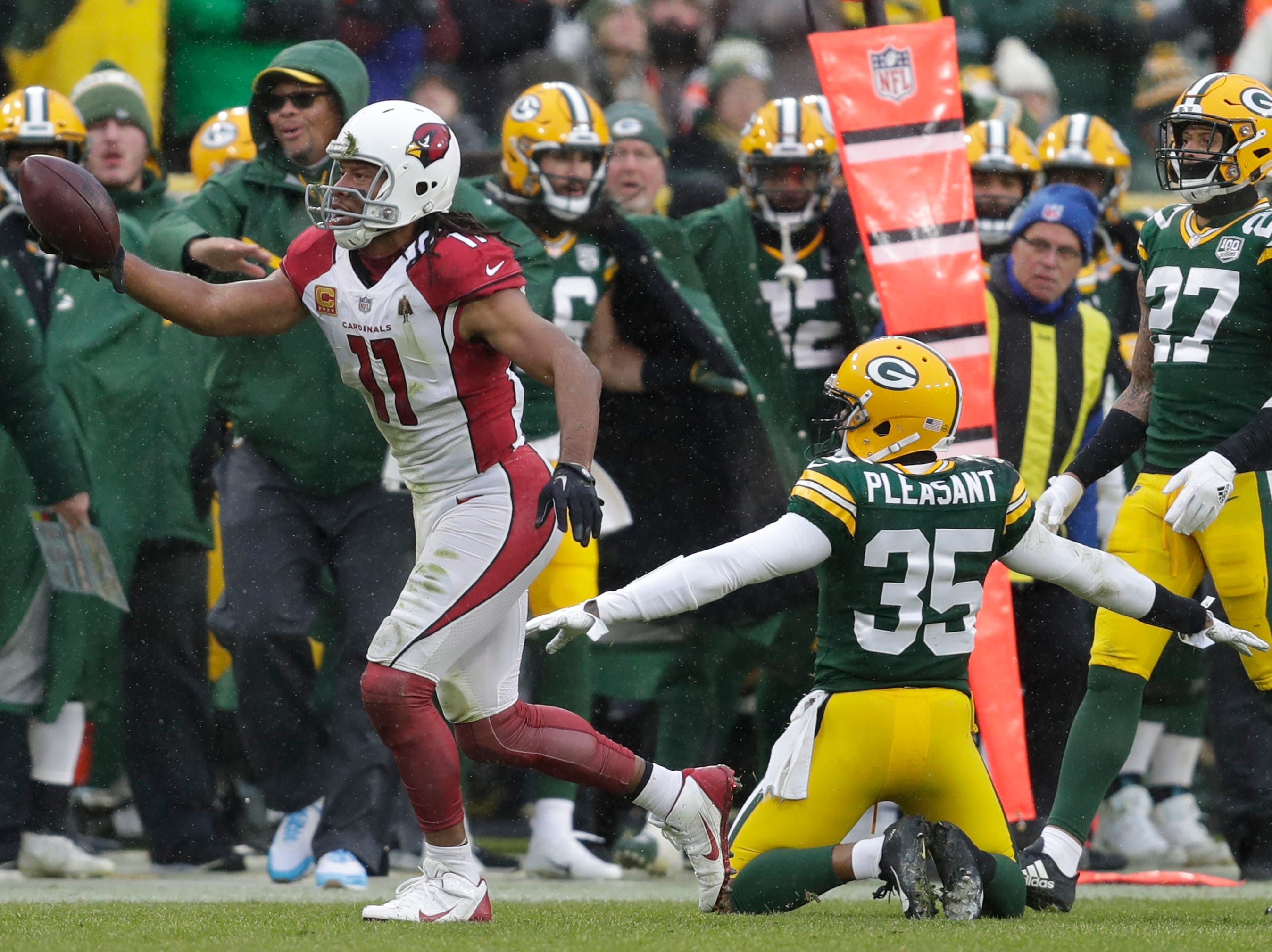 Arizona Cardinals wide receiver Larry Fitzgerald (11) celebrates a long receptiion in the fourth quarter against Green Bay Packers defensive back Eddie Pleasant (35) and cornerback Josh Jackson (37) Sunday, December 2, 2018, at Lambeau Field in Green Bay, Wis. 