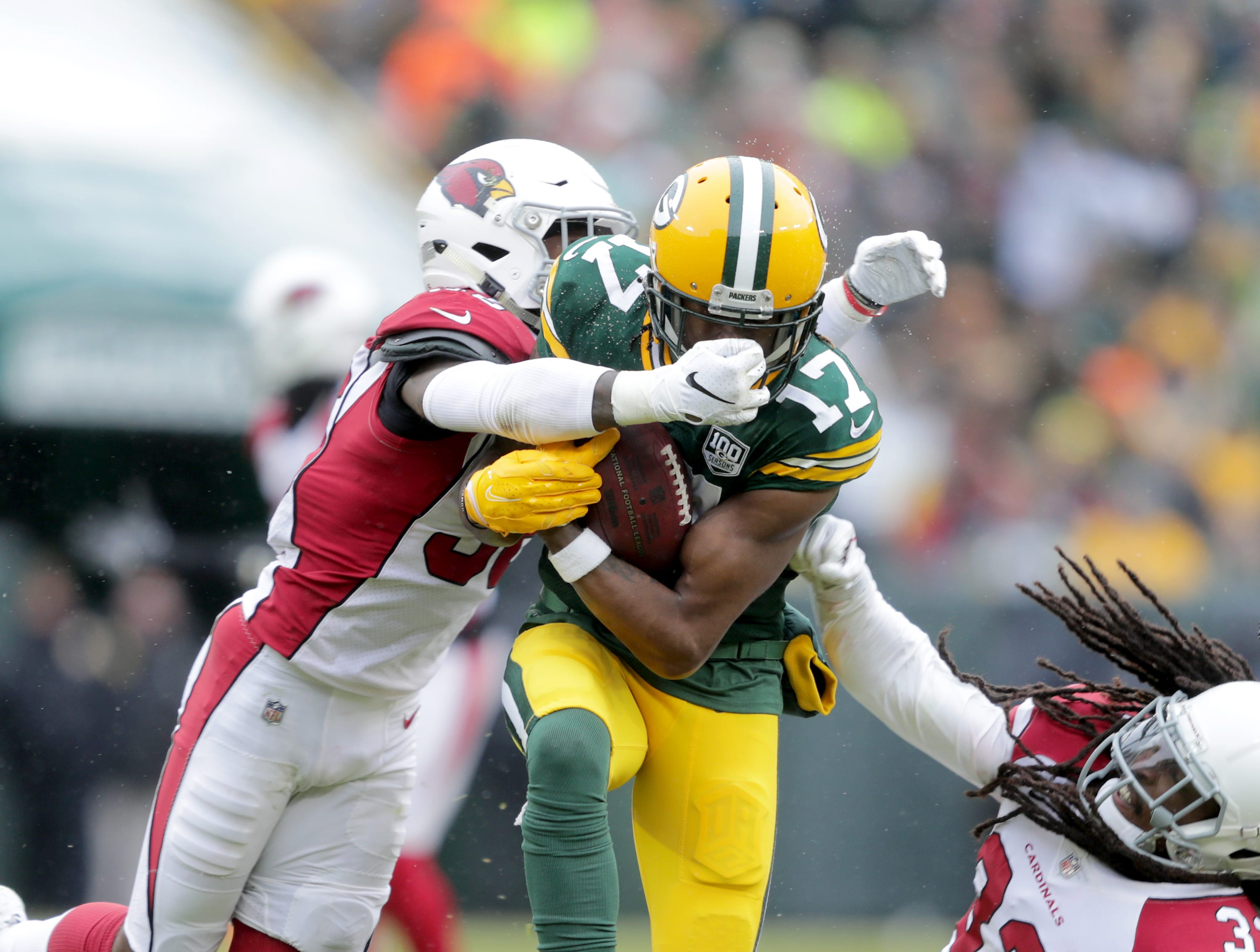 Green Bay Packers wide receiver Davante Adams is tackled by Arizona Cardinals strong safety Budda Baker during  the second quarter of their football game on Sunday, December 2, 2018, at Lambeau Field in Green Bay, Wis.