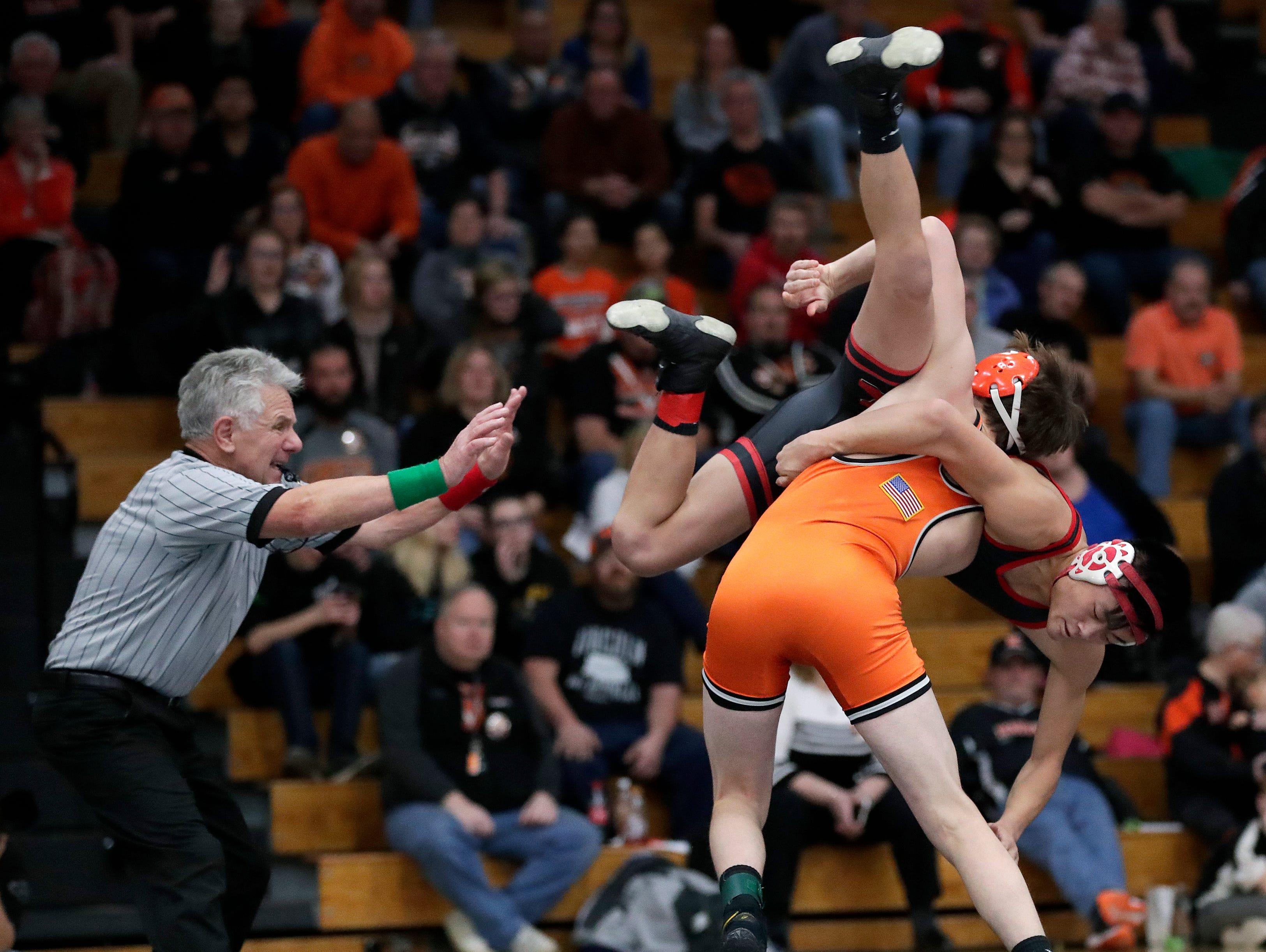 Kaukauna High School's John Diener throws Kimberly High School's Ethan Thao to the mattduring their 138-lb wrestling match Thursday, November 29, 2018, in Kaukauna, Wis. Dan Powers/USA TODAY NETWORK-Wisconsin