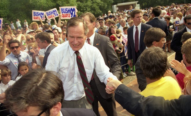 President George Bush greets supporters after speaking at the V.F.W. Post 2179 in Middletown, NJ, on September 9, 1992.
