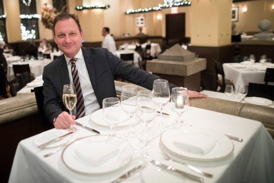 Bret Csencsitz, managing partner of the Gotham Bar and Grill, poses for a portrait at the restaurant in New York. The Manhattan upscale restaurant is contending with higher costs, particularly from rising wages.