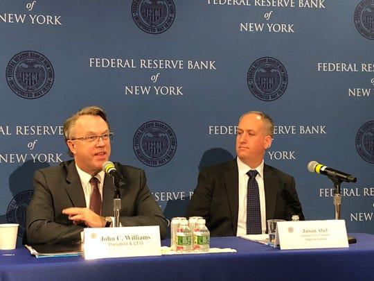 New York Fed President John C. Williams (left) and Jaison Abel, vice president, call for more investment in education.