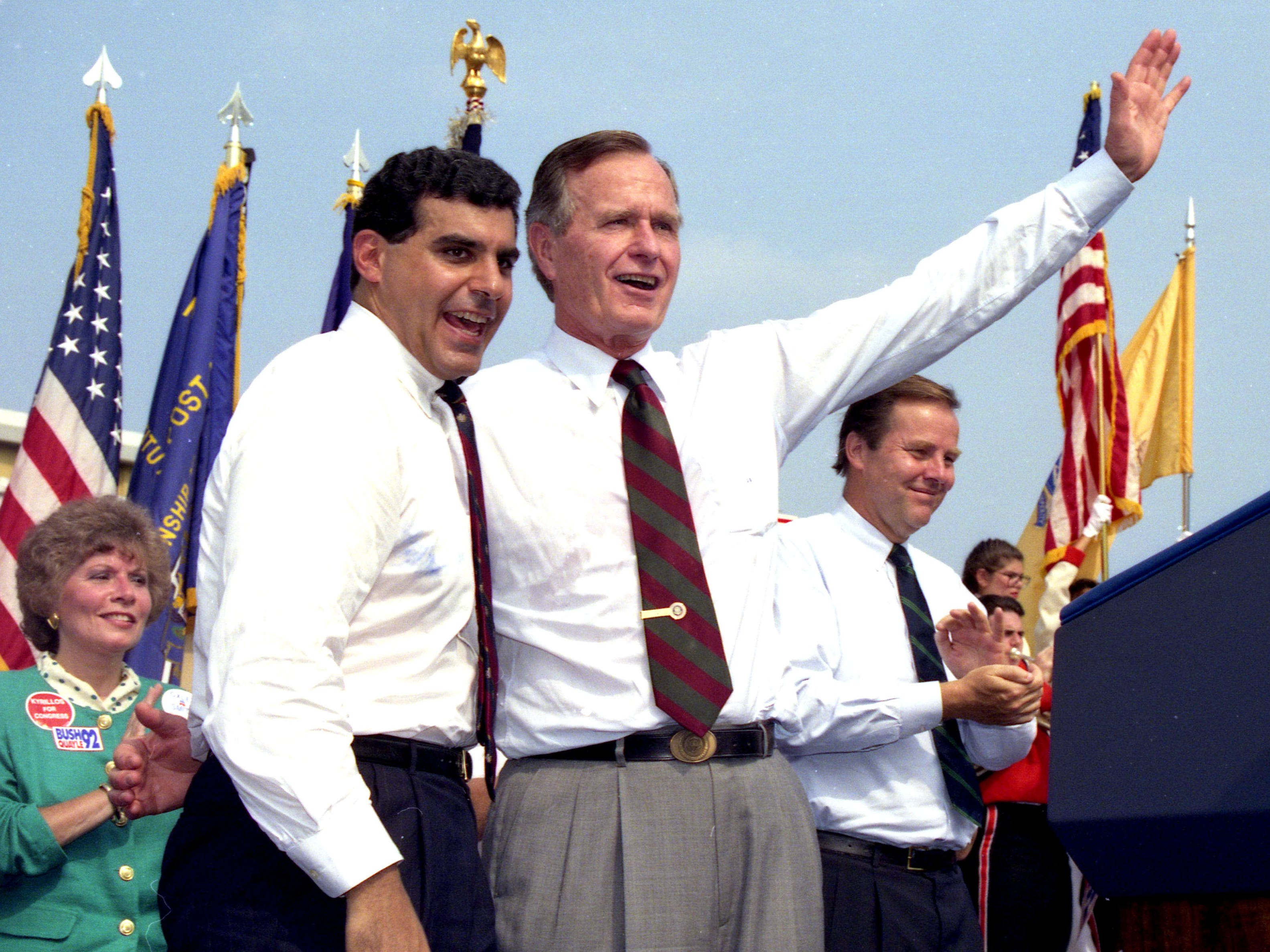 President George Bush waves to the crowd with then-Assemblyman Joseph Kyrillos after speaking at the V.F.W. Post 2179 in Middletown, NJ, on September 9, 1992.