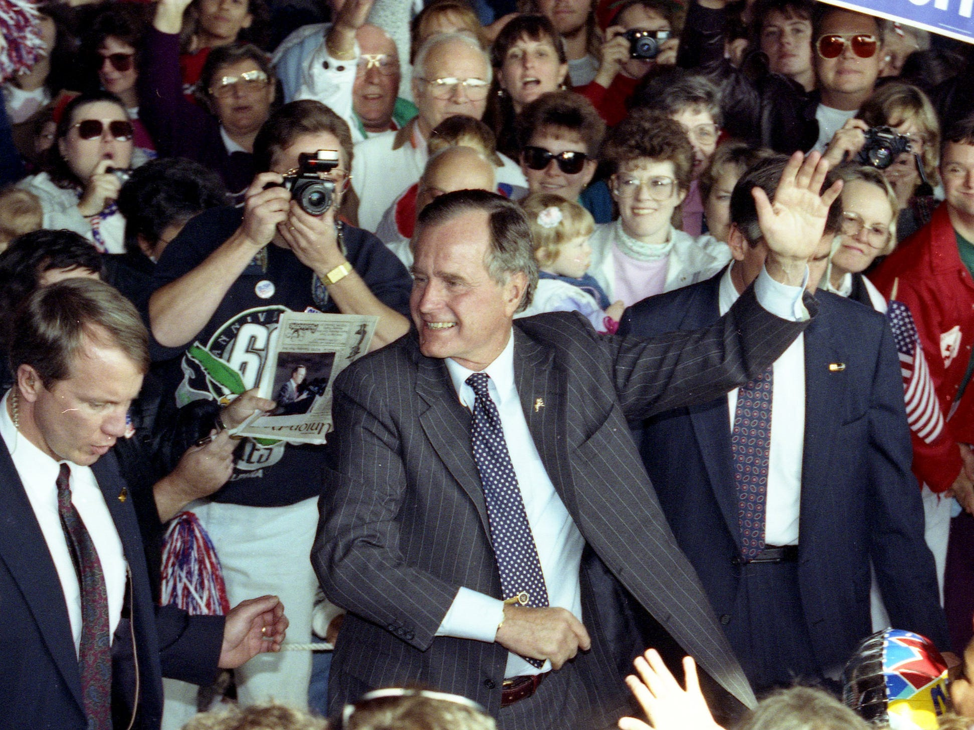 President George HW Bush waves during a campaign rally in Washington Township, NJ, on October 22, 1992.