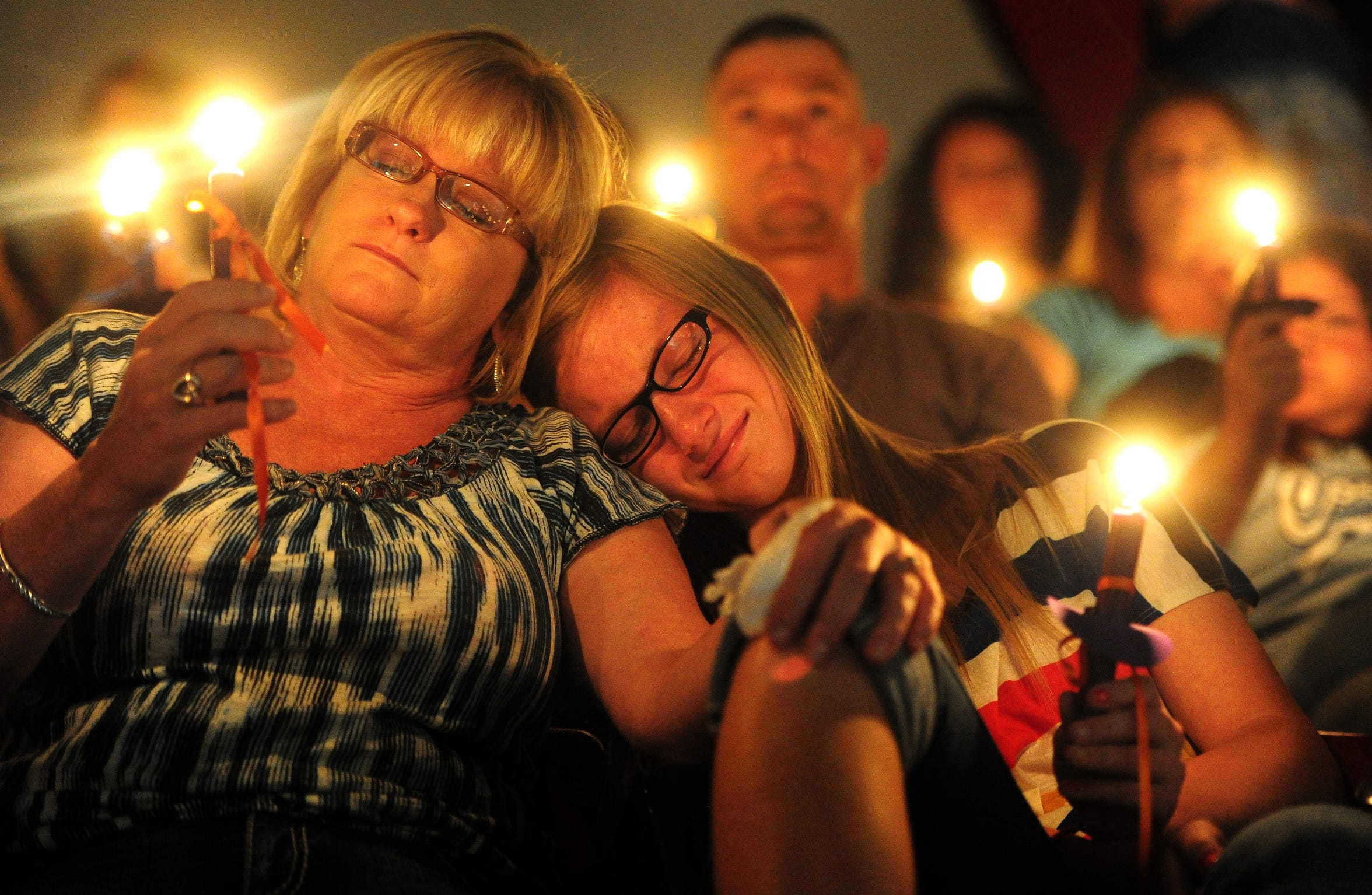 Tracy Hopper comforts her daughter, Maci Hopper,13, as they remember Hailey Dunn during a memorial service May 19, 2013, at Colorado Middle School.