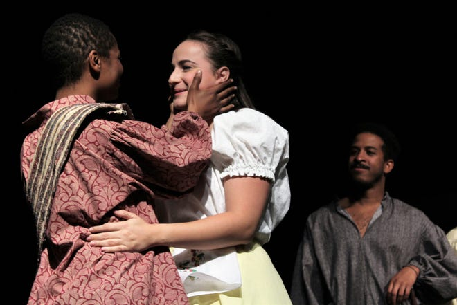 """Othello (Kayla Weinkauf, left) and Desdemona (Verity Pryor-Harden) embrace when reunited in this rehearsal scene from """"Othello,"""" the new Abilene Community Theatre production."""