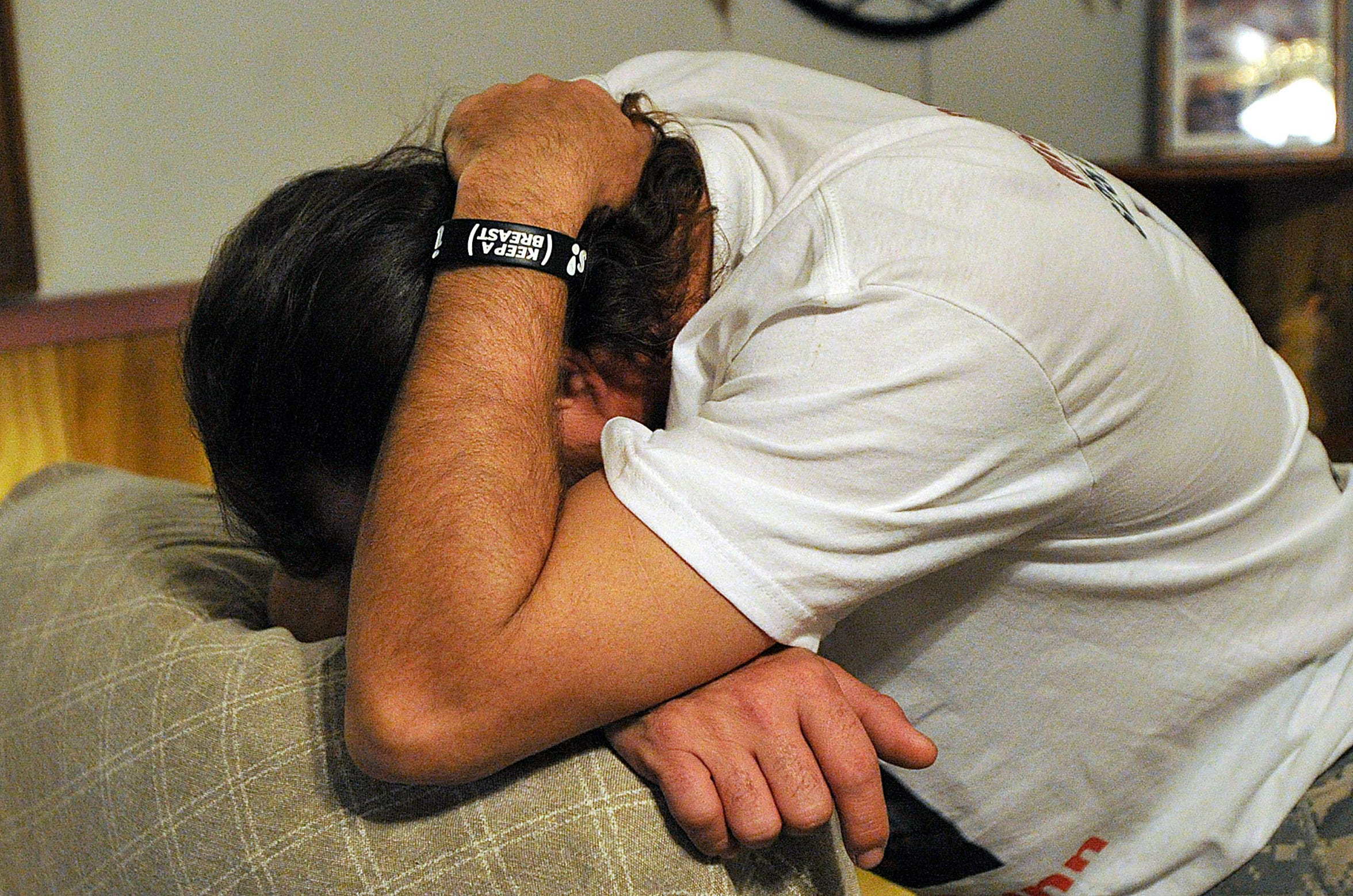 Clint Dunn, the father of missing Colorado City teen Hailey Dunn, buries his face in his arms after hearing news about information pertaining to the case of his missing daughter contained in affidavits obtained from Mitchell County Judge Ray Mayo on Jan. 11, 2011.