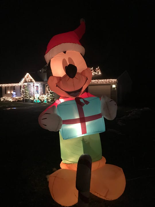 Mickey Mouse greets visitors at the Phillips Festival of Lights  on 1-7 Penny Street in Binghamton.