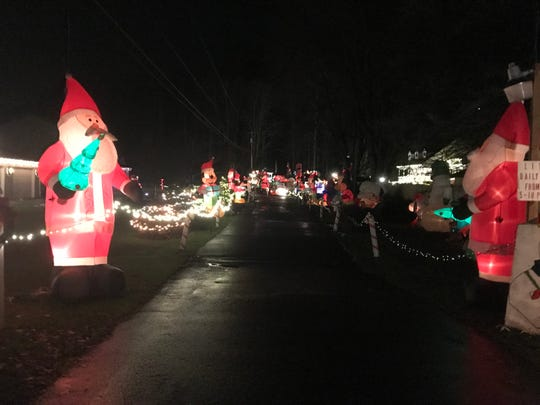 The entrance to the Phillips Festival of Lights on Penny Street in Binghamton is lined with lights and inflatables.