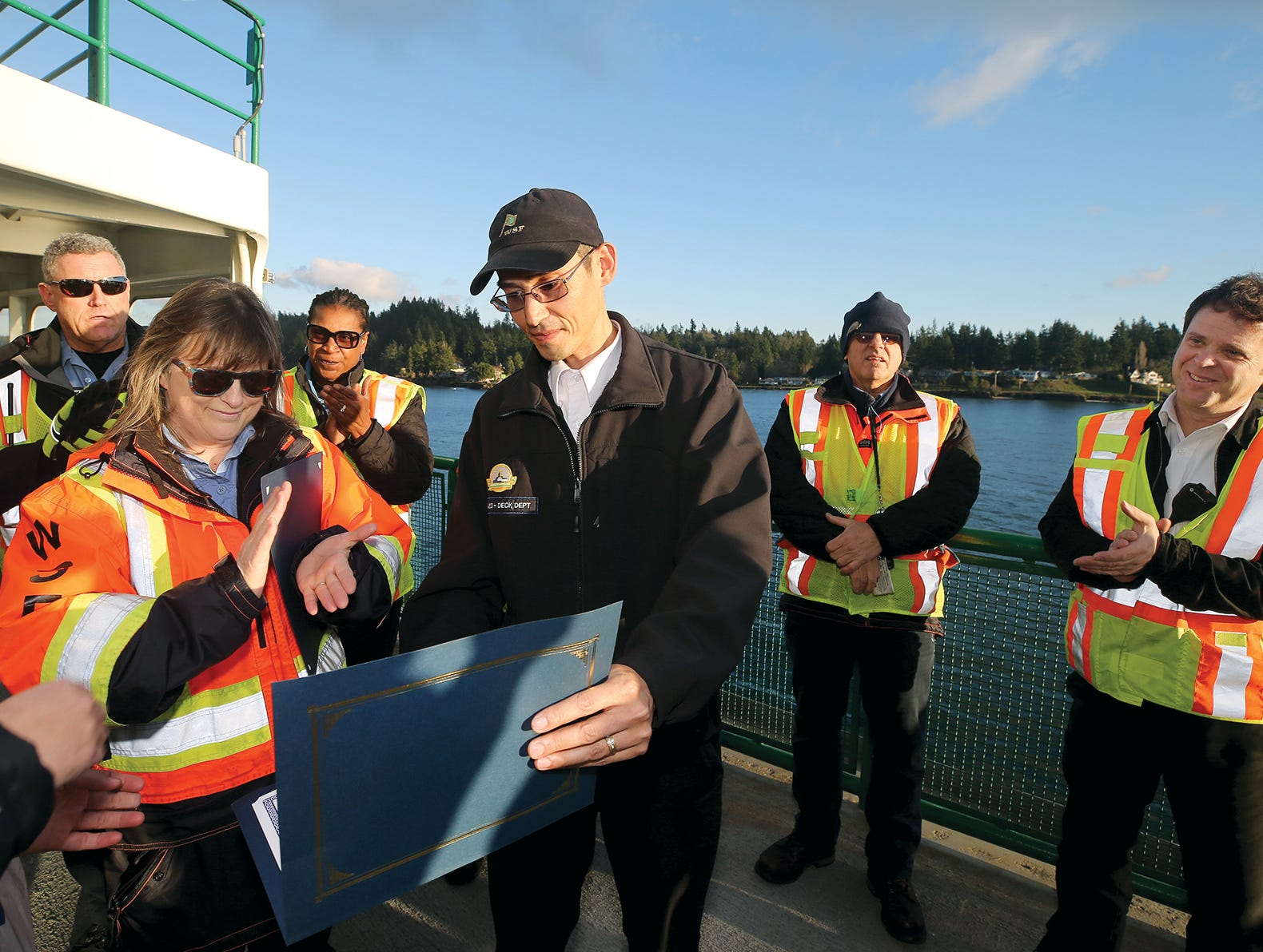 Washington State Ferries workers Donna Phillips, left, of Port Orchard, and James Patheal, center, of Bremerton, were given citations for their bravery on Monday, December 3, 2018. They were two of the Washington State Ferries workers honored Monday for their actions saving a man they found in the ferry lane in Sinclair Inlet in August.