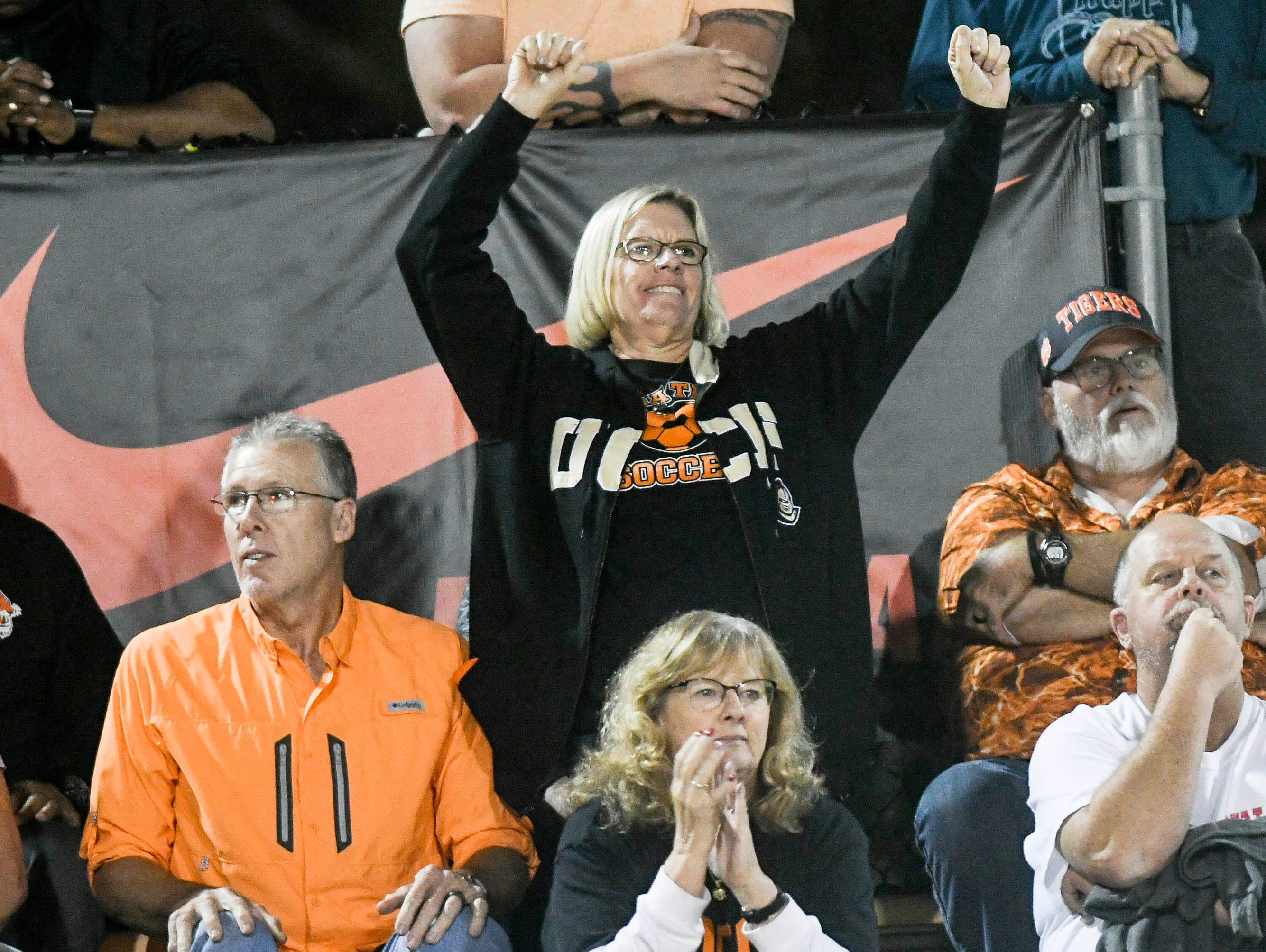 Fans cheer for the Cocoa Tigers during Friday's Class 4A state football semifinal.