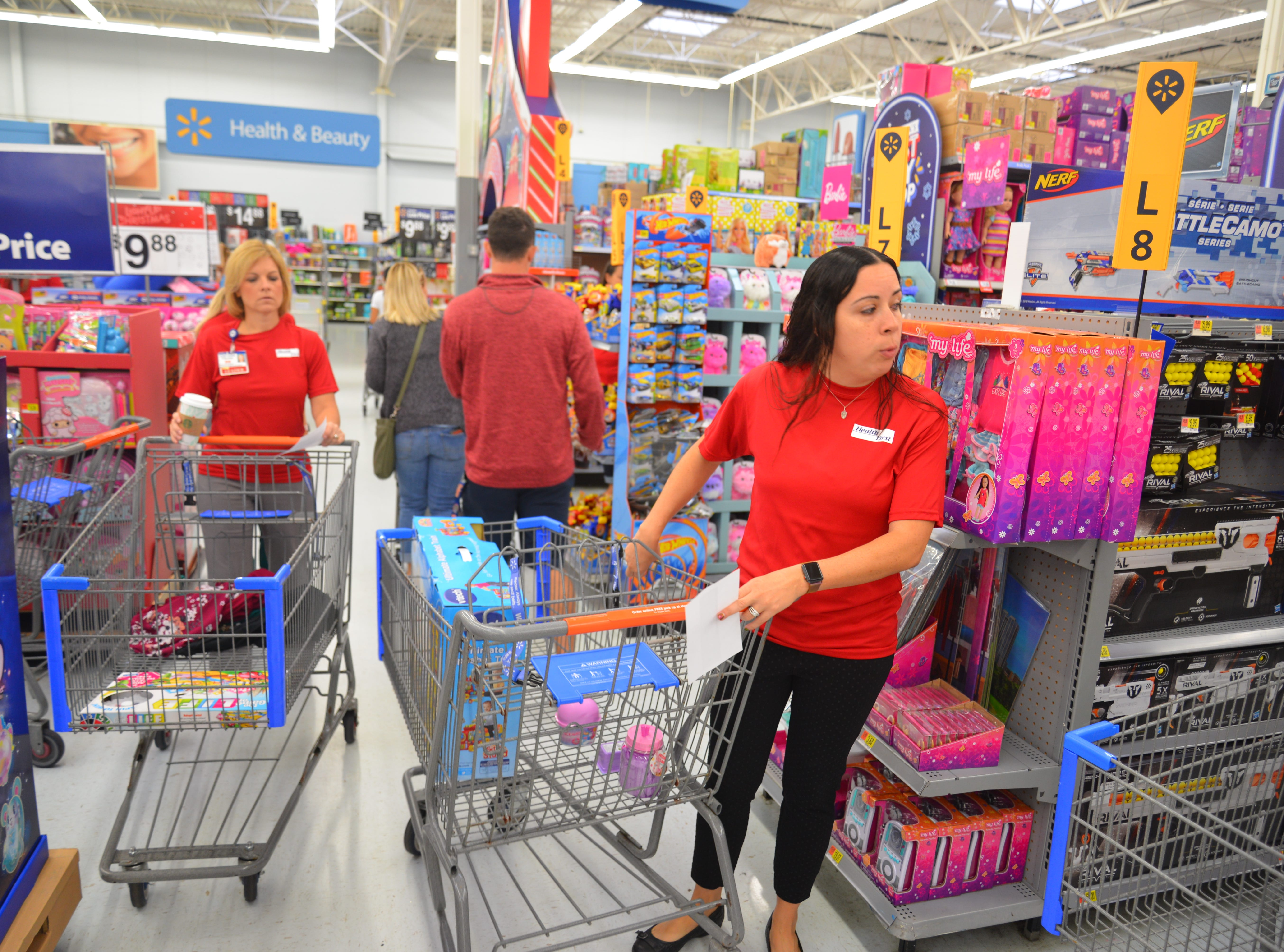 For the sixth year in a row, Health First partnered with the South Brevard Sharing Center to help fulfill wish lists for children who might not receive gifts for the holidays. On Tuesday morning 80 Health First associates in red shirts and volunteers from the South Brevard Sharing Center  descended on Walmart in Viera to purchase gifts for more than 600 children in Brevard County Ñ many of whom are homeless Ñ as part of the Sharing CenterÕs ÒChildren Without Christmas Toy Drive.Ó