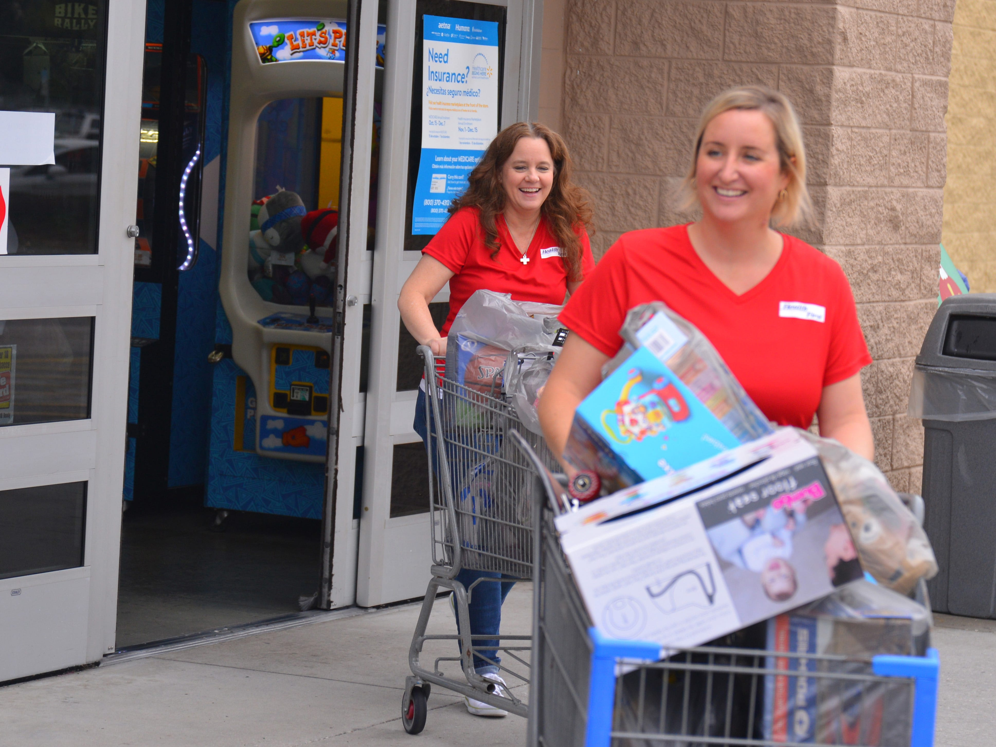 "For the sixth year in a row, Health First partnered with the South Brevard Sharing Center to help fulfill wish lists for children who might not receive gifts for the holidays. On Tuesday morning 80 Health First associates in red shirts and volunteers from the South Brevard Sharing Center  descended on Walmart in Viera to purchase gifts for more than 600 children in Brevard County — many of whom are homeless — as part of the Sharing Center's ""Children Without Christmas Toy Drive."""