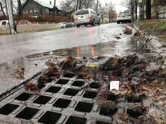 Debris washes into a South Winooski Avenue storm drain in Burlington on Monday, Dec. 3, 2018.