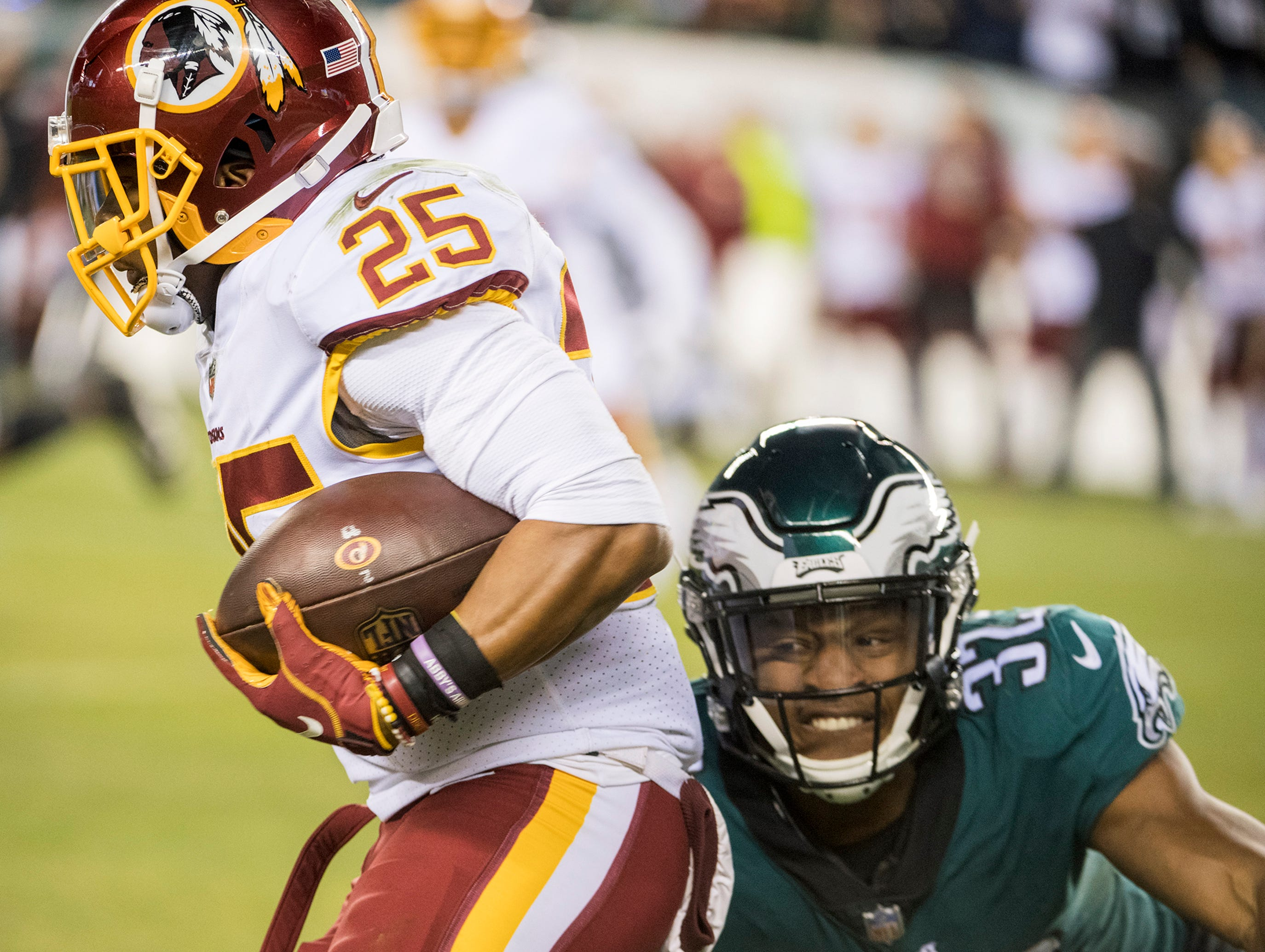 Eagles' Rasul Douglas (32) tackles Chris Thompson (25) Monday, Dec. 3, 2018 in Philadelphia. The Eagles won 28-13.