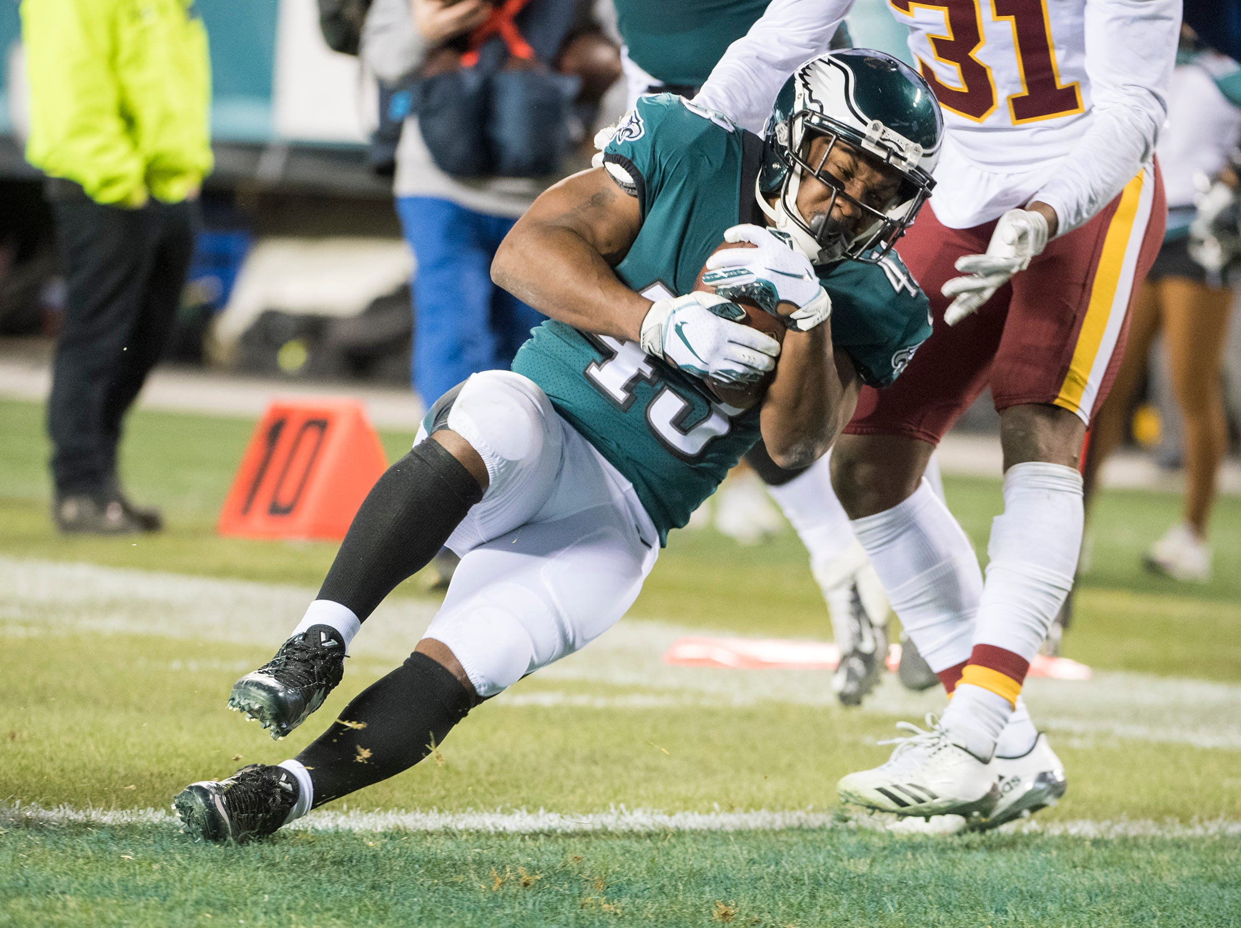 Eagles' Darren Sproles (43) scores against Washington Monday, Dec. 3, 2018 in Philadelphia.
