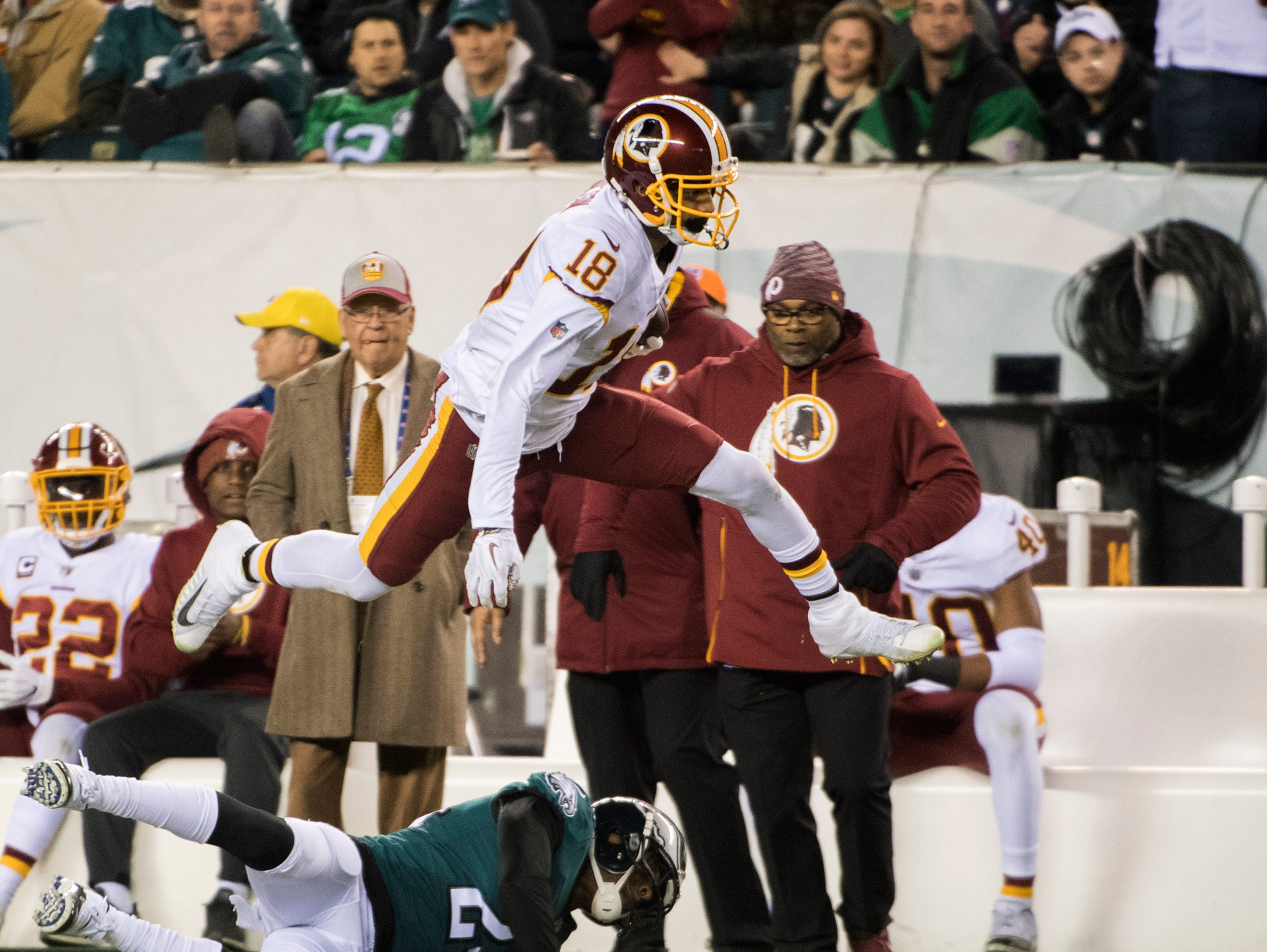 Redskins' Josh Doctson (18) leaps while carrying the ball against the Eagles Monday, Dec. 3, 2018 in Philadelphia. The Eagles won 28-13.