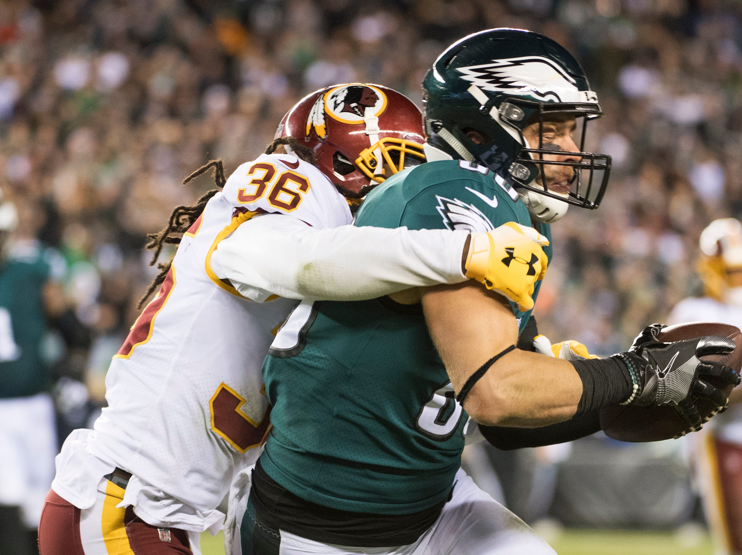 Eagles' Zach Ertz (86) is tackled by Redskins' D.J. Swearinger Sr. (36) Monday, Dec. 3, 2018 in Philadelphia. The Eagles won 28-13.