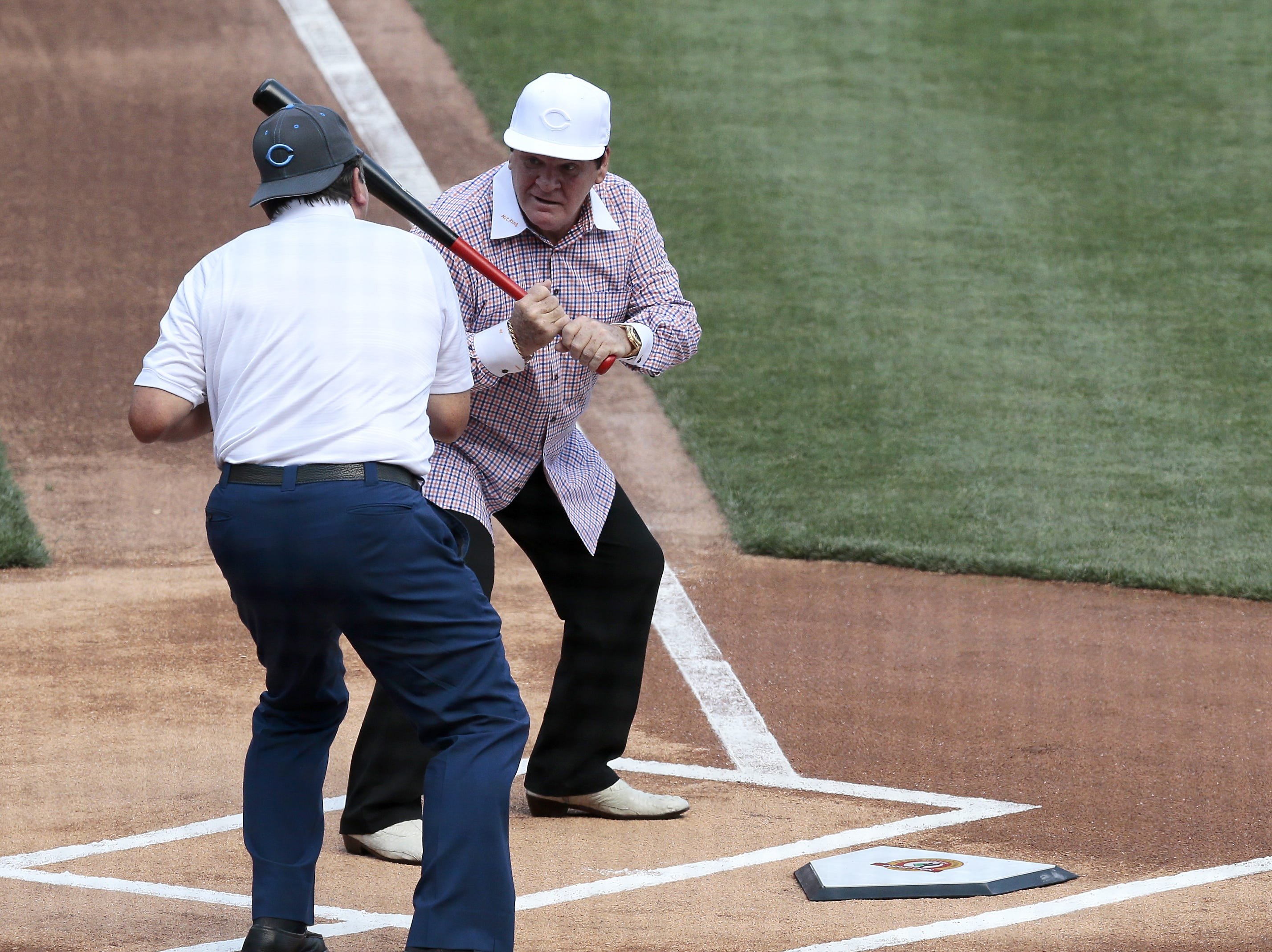 Former Reds great Pete Rose looks back to former team mate Johnny Bench during a ceremonial first pitch before the MLB National League game between the Cincinnati Reds and the San Diego Padres at Great American Ball Park in downtown Cincinnati on Saturday, June 25, 2016.