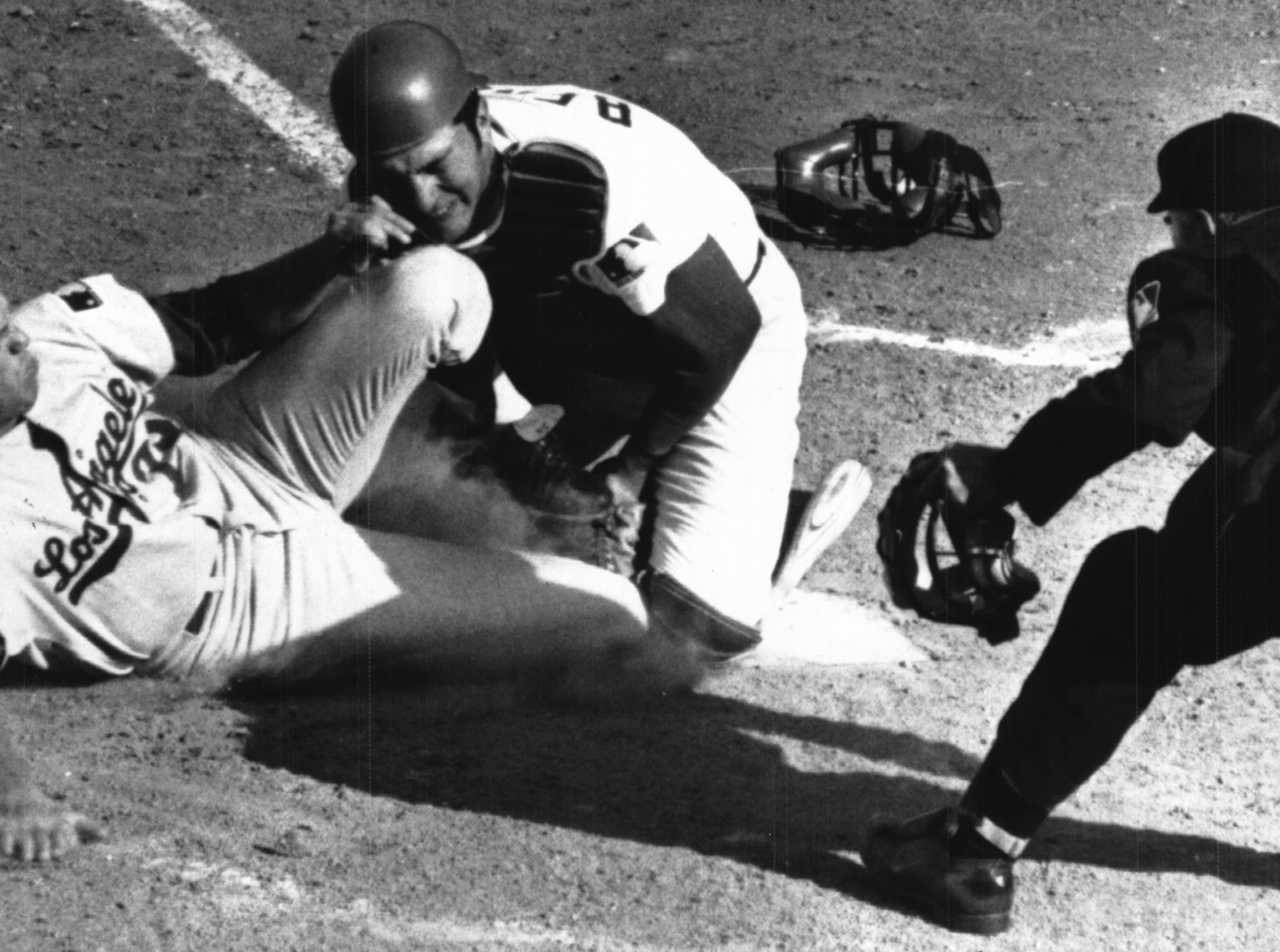 APRIL 8, 1969: A Little Bit Of Violent Contact At Home Plate Monday...Dodgers' West Parker attempts to score from third on grounder in eighth inning is met at home plate by Cincinnati catcher Johnny Bench after throw home by Tony Perez. The Enquirer/Fred Straub