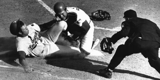 The Dodgers' Wes Parker attempts to score from third as he's met at home plate by Cincinnati catcher Johnny Bench in April of 1969.