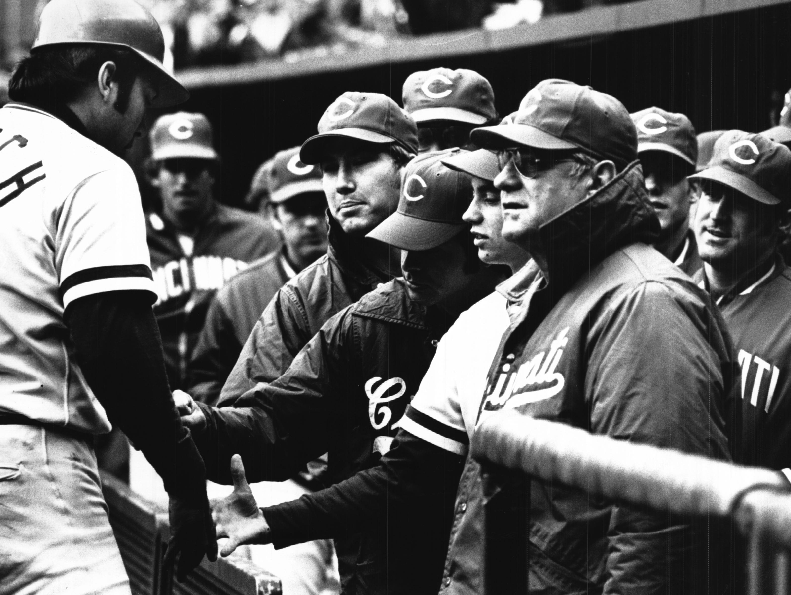 SEPTEMBER 30, 1974: Bench Warmers: You might say Johnny Bench got a chilly reception after his three-run homer in the sixth inning, the way his Reds teammates are dressed on the bench at frigid Riverfront Sunday, 9/29/74. The Enquirer/Ed Reinke