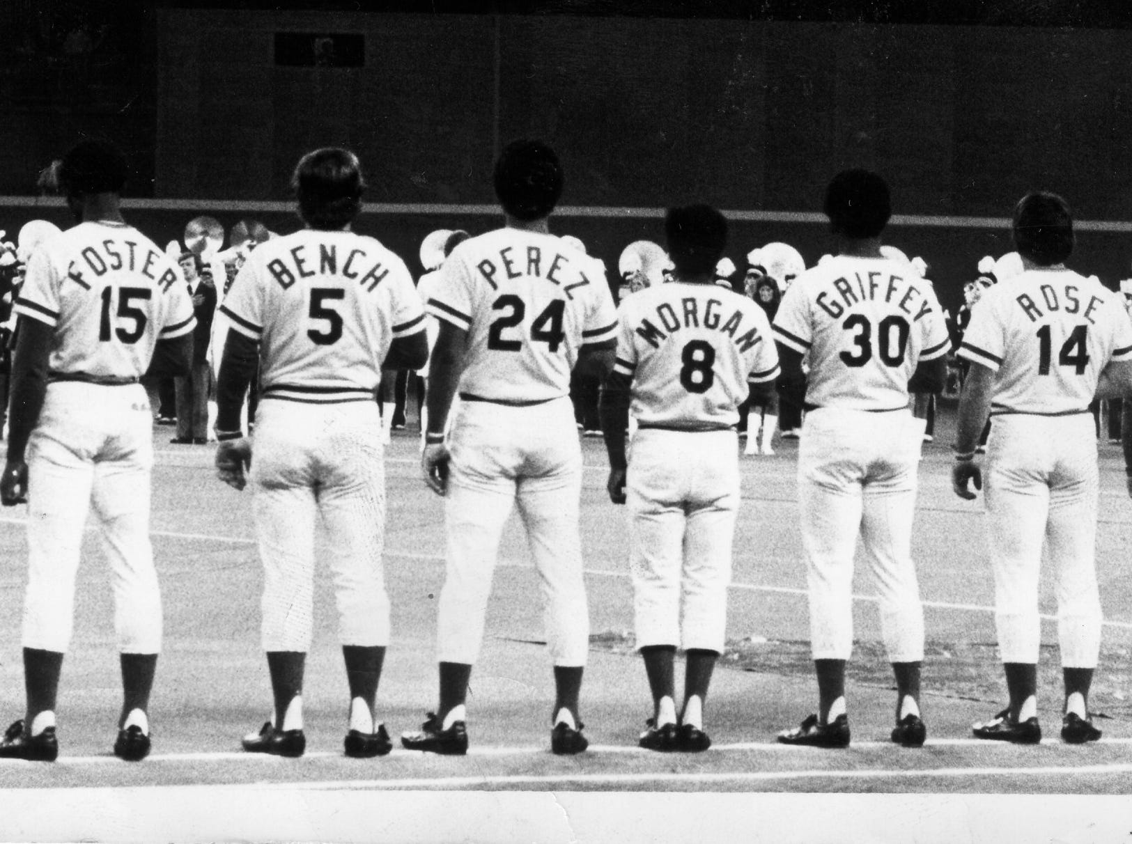Text: World Series Cincinnati Reds 1975. Left to right: Dave Concepcion, George Foster, Johnny Bench, Tony Perez, Joe Morgan, Ken Griffey Sr., Pete Rose and Sparky Anderson.  Game 3, 1975 World Series, Riverfront Stadium October 14, 1975 The Enquirer/Fred Straub.