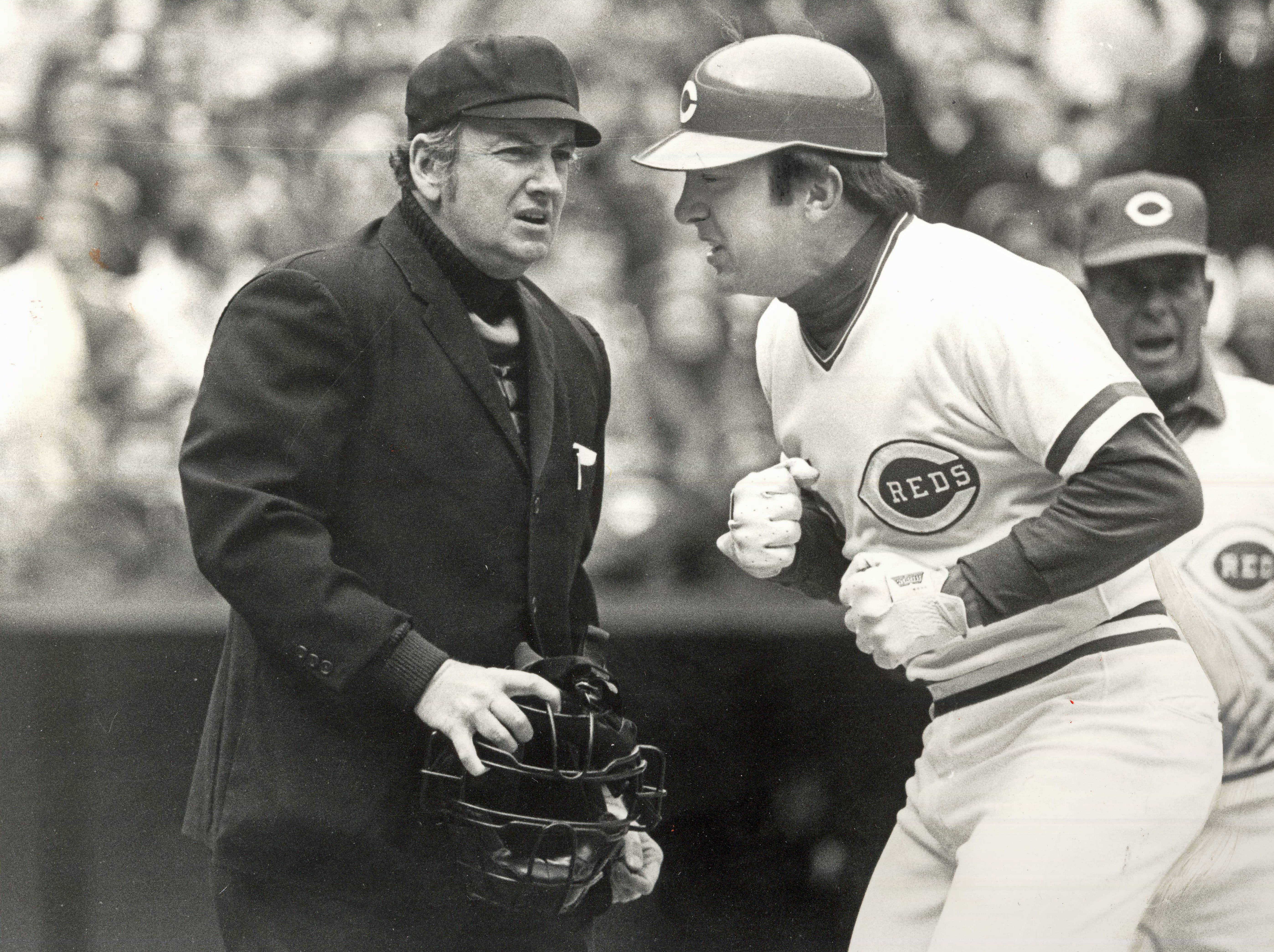 """APRIL 15, 1979: Reds' catcher Johnny Bench takes exception to the """"sweep tag"""" call by umpire Roger Grooms, a member of the Queen City Umpires' Association, in last Saturday's 4-2 loss to the Giants. The Enquirer/Natalie Fobes Scanned 6/21/2018"""