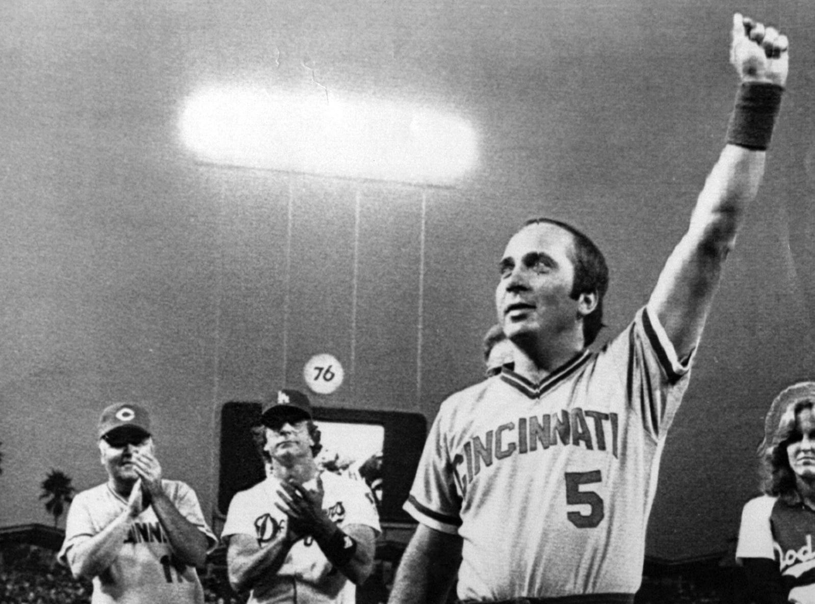 SEPTEMBER 8, 1983: Cincinnati Reds catcher Johnny Bench waves farewell to the fans during a special pre-game presentation at Dodger Stadium Wednesday night. This is the last Dodgers-Reds series in Los Angeles before Bench's retirement. Taking part in the ceremonies were comedian-celebrity Jonathan Winters, in Reds uniform at left, and Dodgers catcher Steve Yeager, center. AP Photo/Doug Pizac scanned August 23, 2013