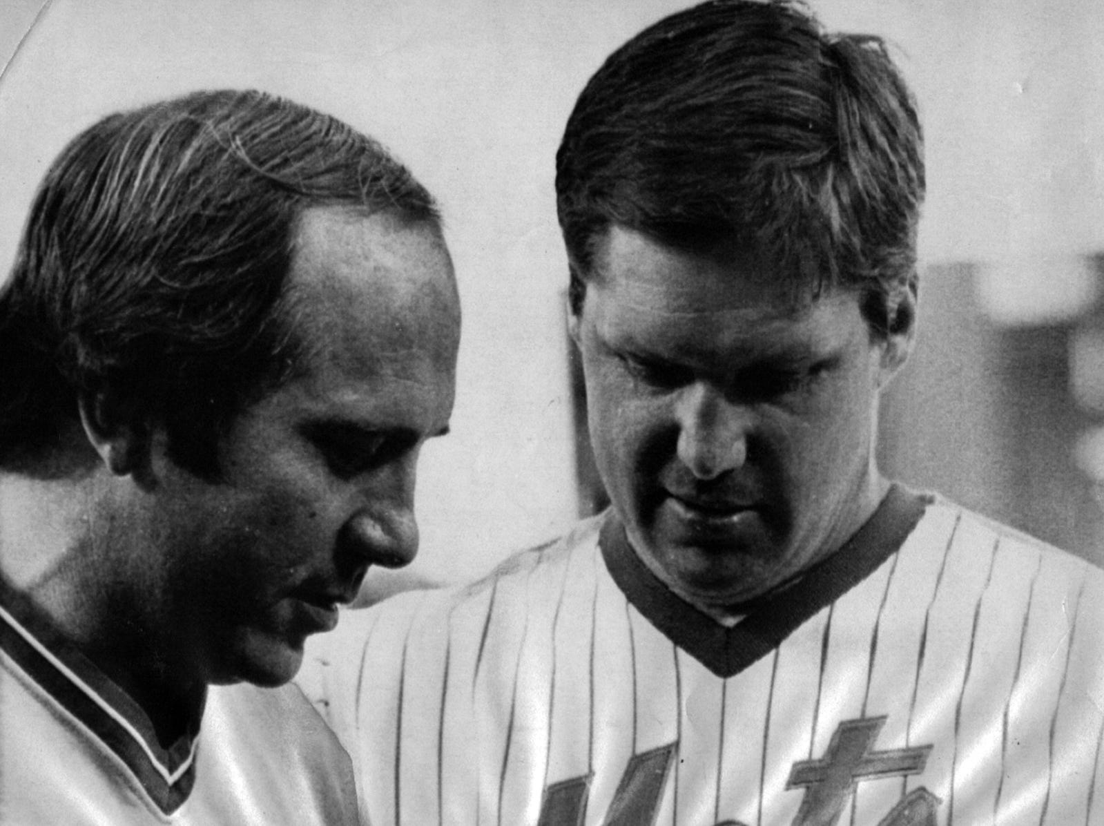 JULY 14, 1983: The Cincinnati Reds Johnny Bench, left, who is retiring after this season from baseball gets a pendant from former teammate and now a New York Met, Tom Seaver before the game at Shea Stadium. Bench did not play in the game but the Reds rolled over the Mets 3-1 in the second game of the series. AP Photo/G. Paul Burnett scanned August 26, 2013 FROM A SUNDAY SEPTEMBER 11, 1983 CAPTION: His last trip around the league included reunions with the likes of Joe Morgan, Pete Rose and Tony Perez in Philadelphia. After being honored by the Phillies, Bench went out and bear them with a three-run pinch-hit homer. At the ceremonies in New York, Bench shared a moment with his good friend and former batterymate, Tom Seaver, pictured.