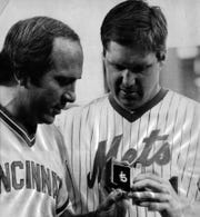 JULY 14, 1983: The Cincinnati Reds' Johnny Bench, left, gets a pendant from former teammate and now New York Met, Tom Seaver, before the game at Shea Stadium.