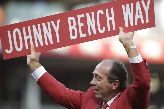 SATURDAY SEPTEMBER 17, 2011 BENCH  SPORTS Johnny Bench was honored on the field by the CIncinnati Reds before the game with the Milwaukee Brewers.  The City of CIncinnati also presented Bench with a street sign that names a portion of a street near the ball park Johnny Bench Way. Prior to the ball park ceremony, the much anticipated Johnny Bench statue was unveiled in the breeze way outside the Reds Hall of Fame and Museum at Great American Ball Park.    The Enquirer/Michael E. Keating