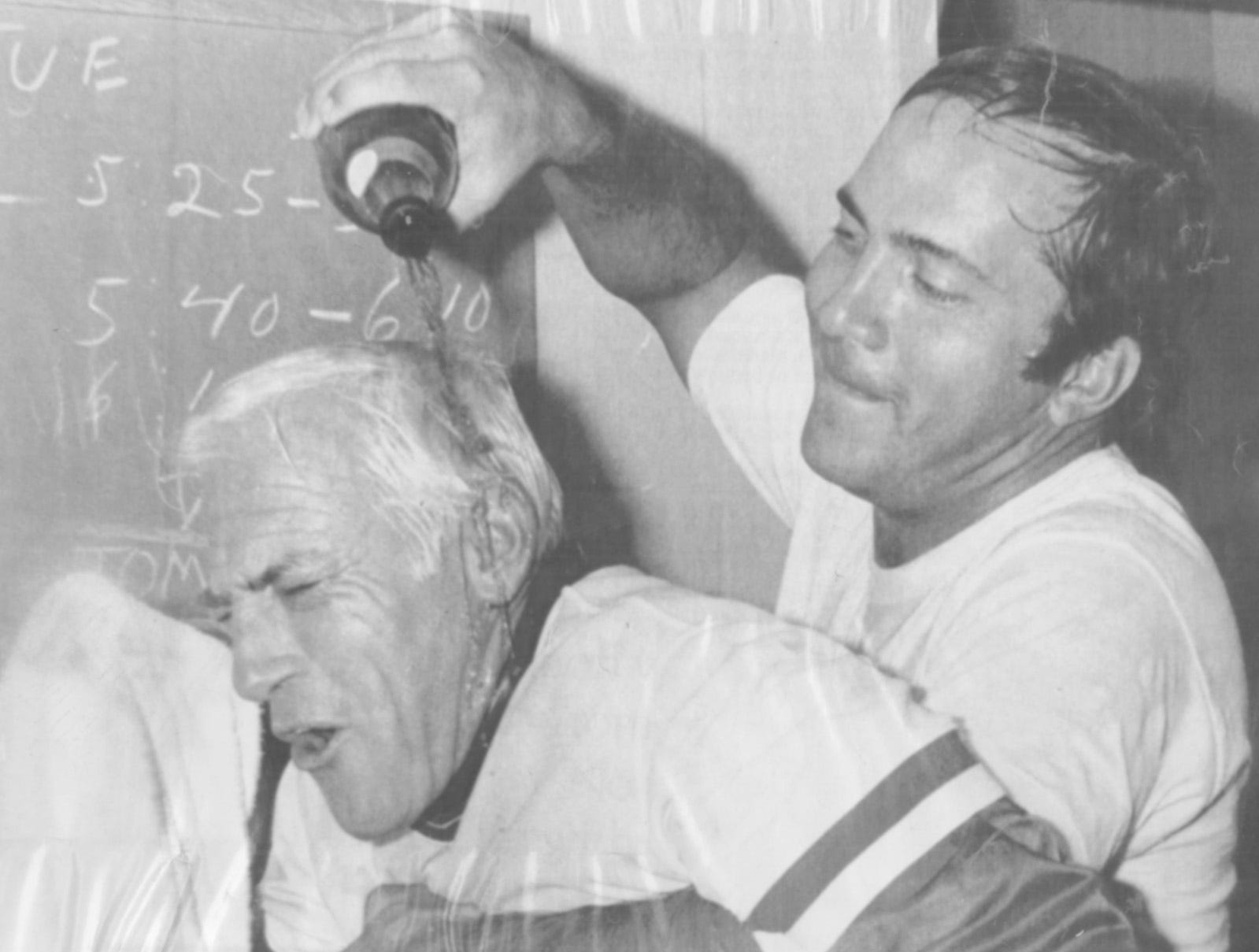 Cincinnati Reds catcher Johnny Bench, right, pours champagne over Reds manager Spary Anderson during the celebration in the clubhouse after the Reds won the National League Western Division title in 1976.