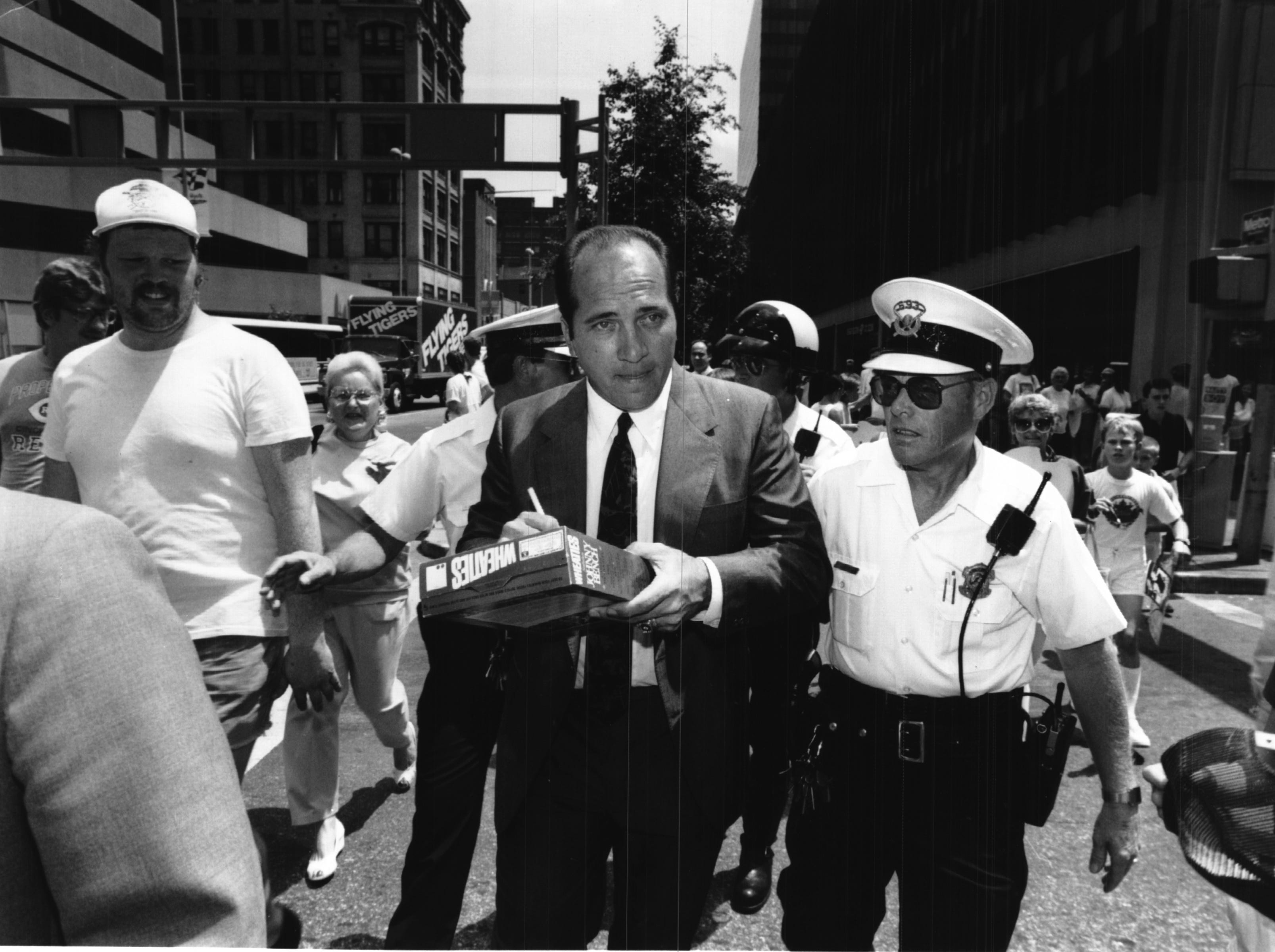 JULY 18, 1989: Johnny Bench signs autographs on Wheaties cereal box during ceremonies on Fountain Square. The Enquirer/Gary Landers