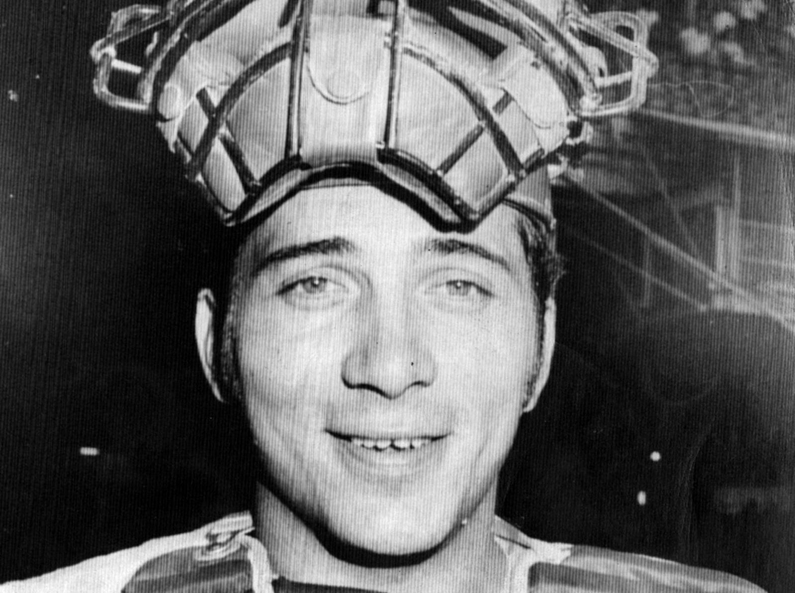 AUGUST 27, 1970: Johnny Bench, Cincinnati Reds standout catcher and hitter, manages a small smile as he poses with face mask perched atop helmet looking like a crown before start of Wednesday night game with Philadelphia Phillies in Philadelphia. In interview before game Bench said the only thing he wants more than success is the ability to handle it. AP Photo scanned August 7, 2013
