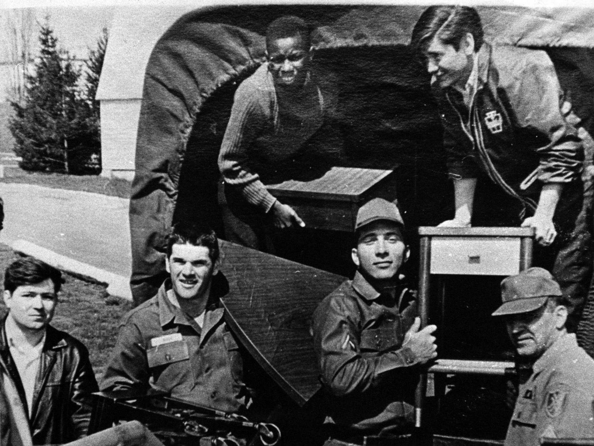 PHOTO TAKEN SOMETIME AROUND 1969 OR 1967: Pete Rose, second from left, and Johnny Bench, third from left, unload furniture while on duty with the Army Reserves in Fort Thomas, Ky. The Enquirer/Allan Kain scanned August 18, 2010