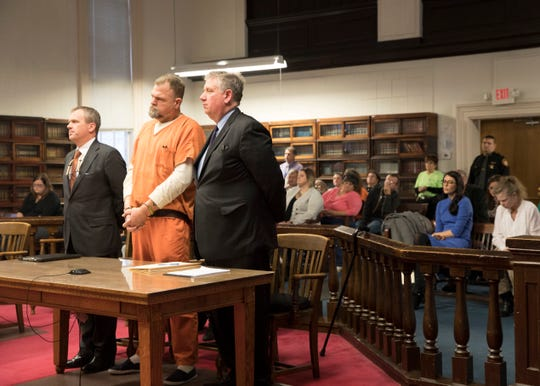 """Rhoden and Wagner family members watch as George """"Billy"""" Wagner III pleads not guilty to Judge Randy Deering at the Pike County Courthouse on Tuesday, December 04, 2018, in Waverly, Ohio. George Wagner III is facing murder chargers, along with his wife and sons relating to the deaths of seven Rhoden family members and Hannah Gilley over a possible custody dispute. The eight homicides took place in April of 2016."""