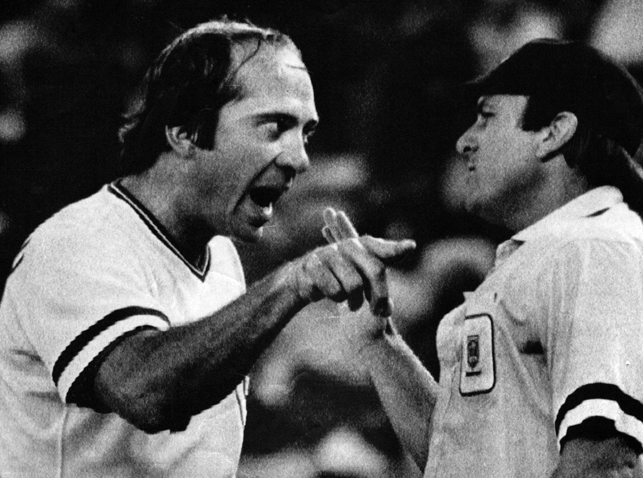 SEPTEMBER 17, 1982: Cincinnati Reds third baseman Johnny Bench makes a rather emphatic point with home plate umpire Ed Montague during the third inning of a game against the Atlanta Braves, Friday night in Cincinnati. Bench had jumped into an argument between Reds hitter Ron Oester and Montague over a called strike. Tempers were calmed and play soon resumed. The Enquirer/Ed Reinke scanned August 6, 2013