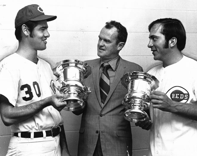 JULY 11, 1971: For Job Well Done: Yes, Reds fans, there is a National League pennant at Riverfront Stadium. Jim Merritt, left, and Johnny Bench, right helped put it there. To mark 1970 achievements, Cincinnati chapter, Baseball Writers Association of America, honored Merritt, pitcher of year and Bench, most valuable player. Chapter chairman Bill Ford of The Enquirer made presentations. Bernie Carbo, newcomer of 1970, also was honored. The Enquirer/Bob Free