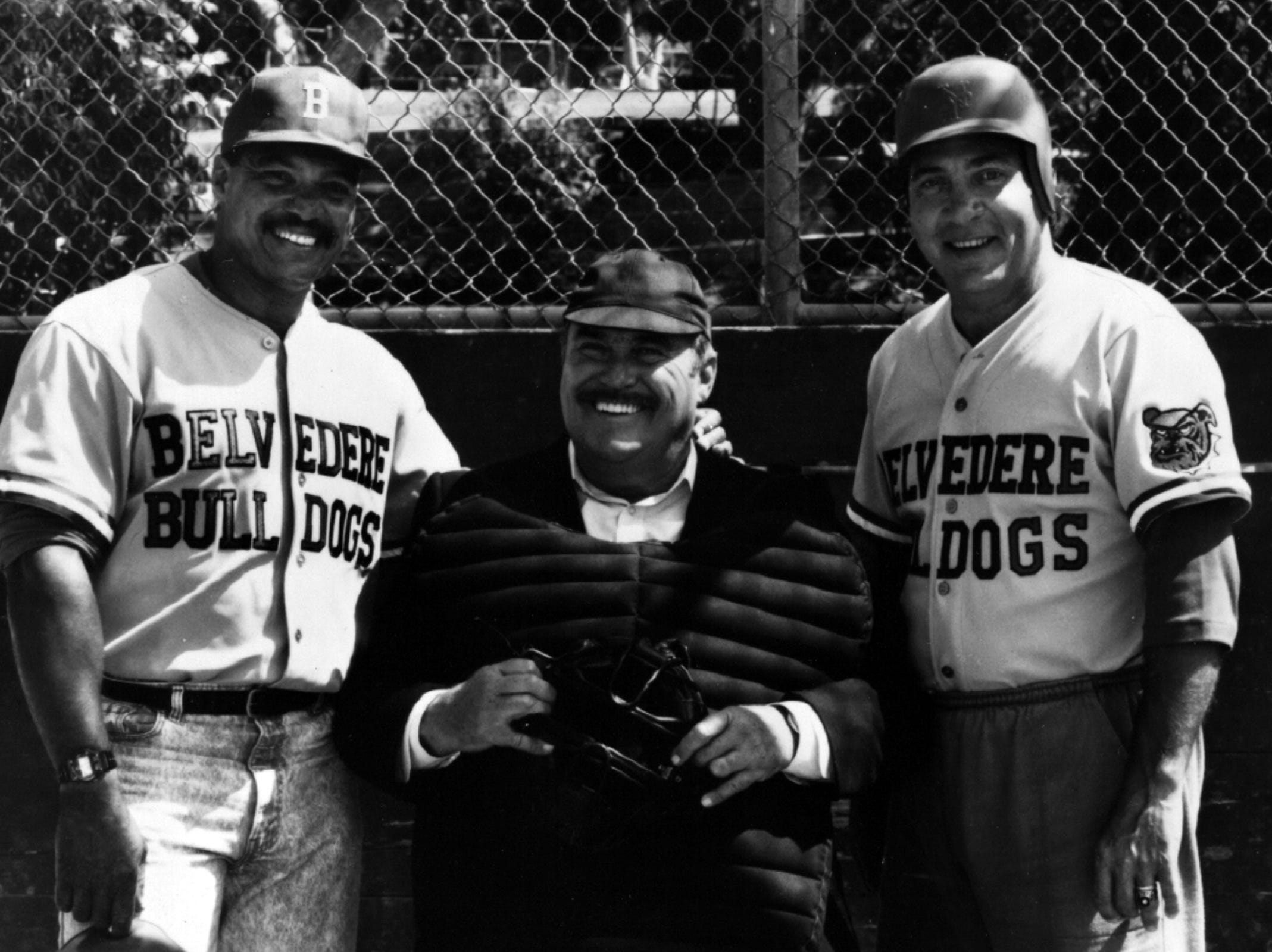 """1989: A couple of real-life heavy hitters, Baseball Hall of Famers Reggie Jackson, left, and Johnny Bench, right, join the Belvedere Bulldogs, and Christopher Hewett, who will call 'em as he sees 'em as Lynn Belvedere, in """"The Field,"""" a baseball-oriented premiere episode for """"Mr. Belevedere,"""" beginning the 1989-90 season on the ABC Television Network, Saturday, Sept. 16 (8:00-8:30 p.m., ET). Photo credit: 1989 copyright Capital Cities/ABC, Inc. scanned August 8, 2013"""