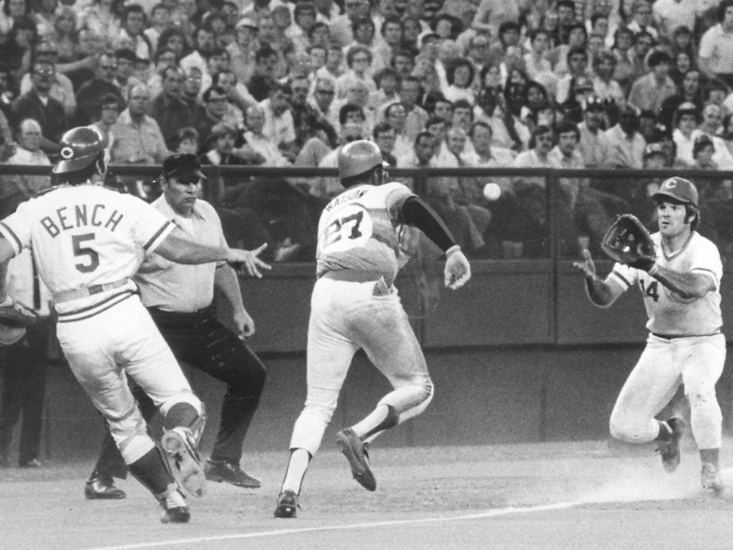 Bob Watson of the Houston Astros is trapped between Reds' catcher Johnny Bench and third baseman Pete Rose with Bench flipping the ball to Rose for the tag in the rundown during their July 1, 1975 game. The Enquirer/Mark Treitel