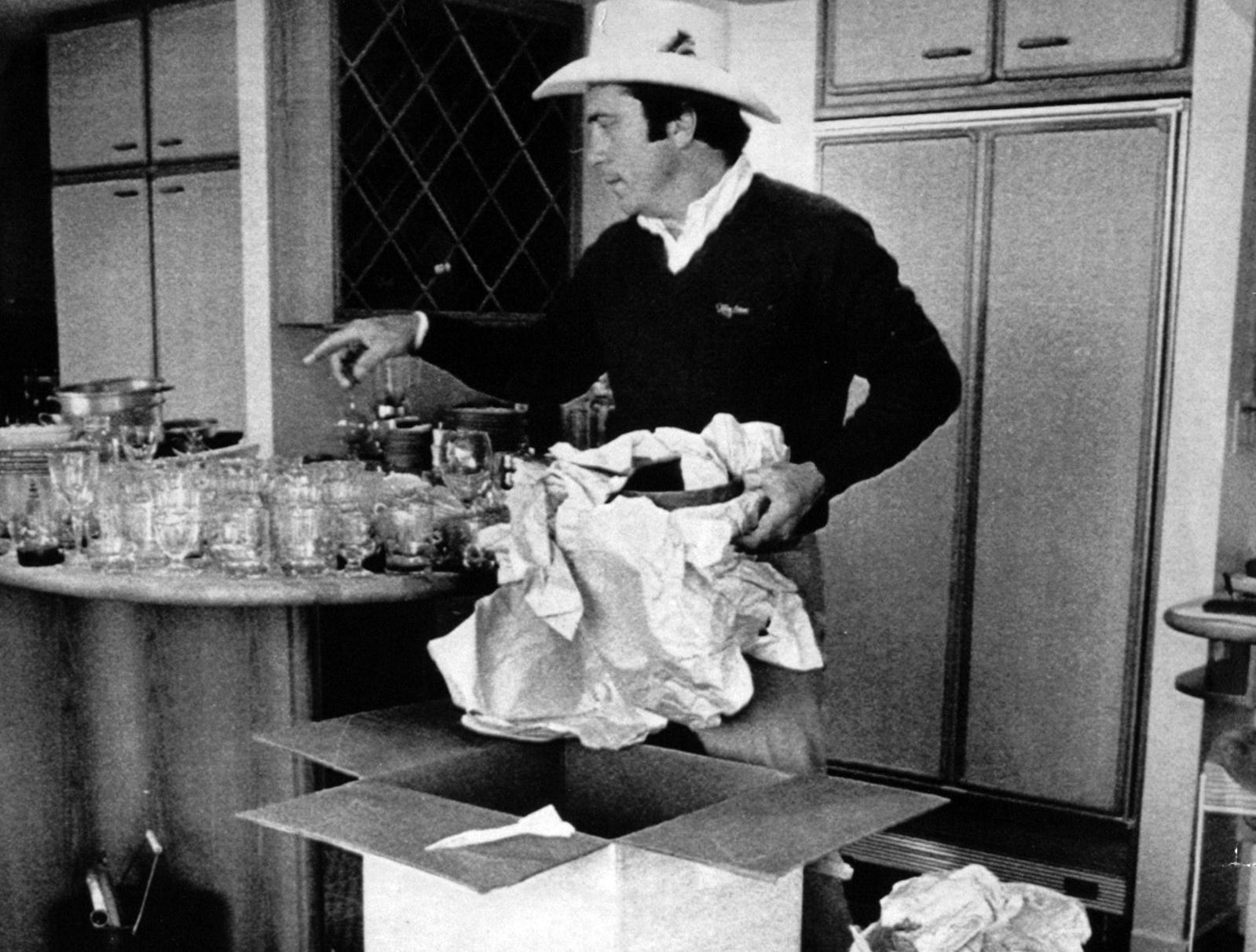 DECEMBER 1, 1982: Cincinnati Reds player Johnny Bench unpacks inside his new home in Cincinnati Tuesday. The former National League Most-Valuable-Player had his home destroyed in a fire last January in a blaze that was estimated to have caused $650,000 damage. The Enquirer/Mark Treitel scanned August 8, 2013
