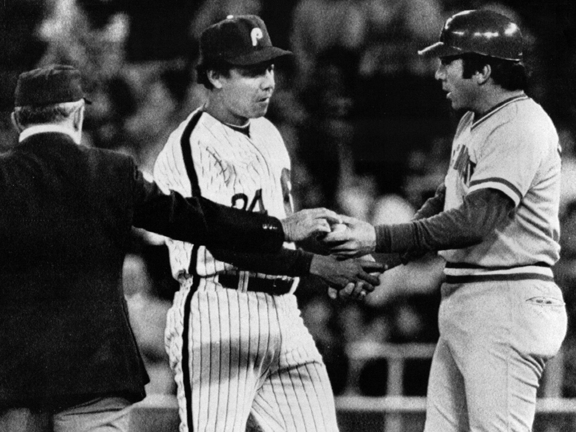 MAY 5, 1983: Cincinnati Reds Johnny Bench gets a hand shake form former teammate Phillies first baseman Tony Perez as the umpire hands him the ball following his 2,000 career it Wednesday night in Philadelphia. Bench's single came off Phillies Steve Carlton but the Phillies won, 9-4. AP Photo/Peter Morgan scanned August 7, 2013