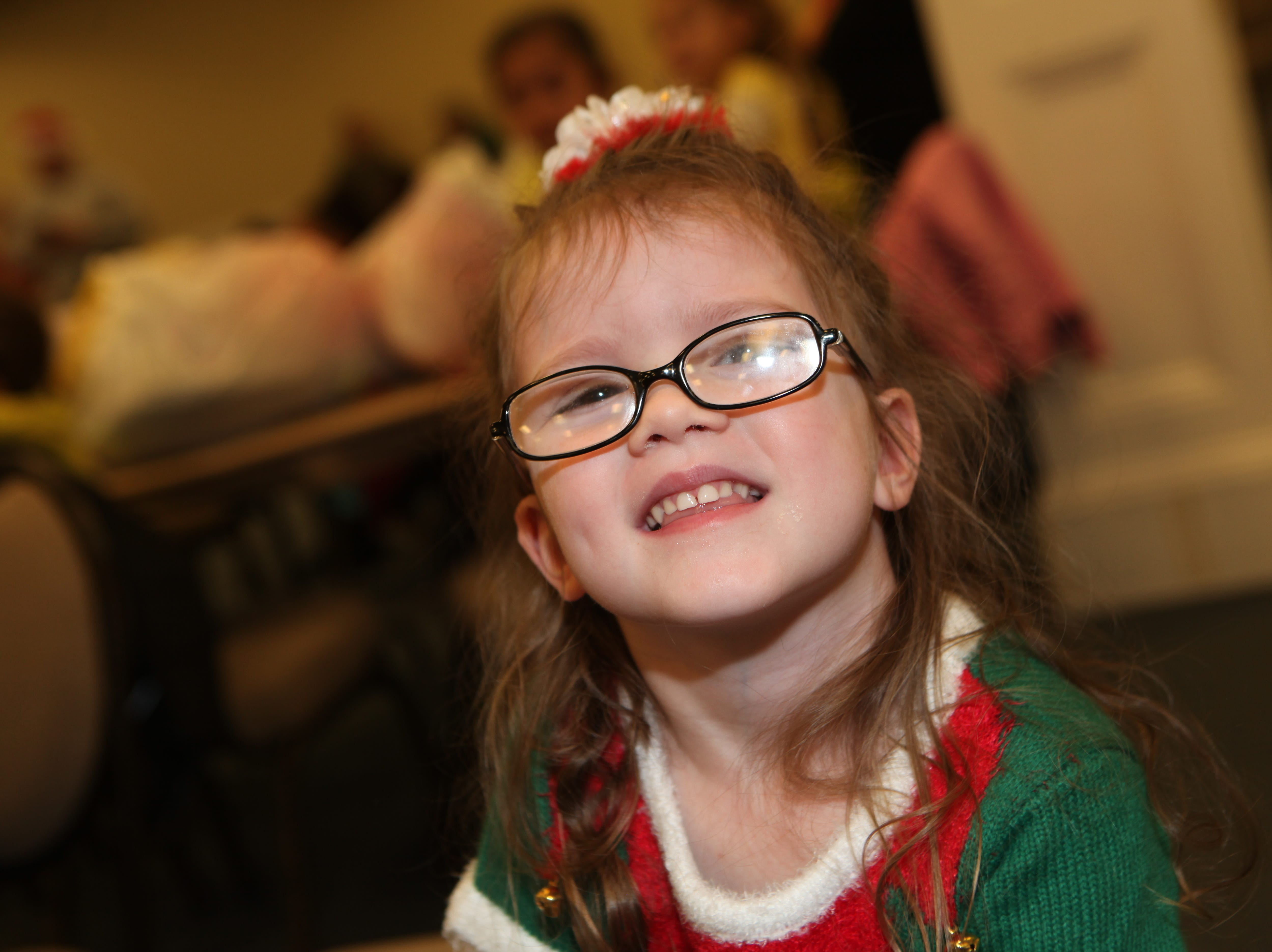 Evalynne smiles during the Clarksville Kiwanis Club's annual Christmas Party giving 144 Head Start children a visit with Santa Claus and a bag full of early Christmas presents, Dec. 4, 2018 in Clarksville, Tenn.