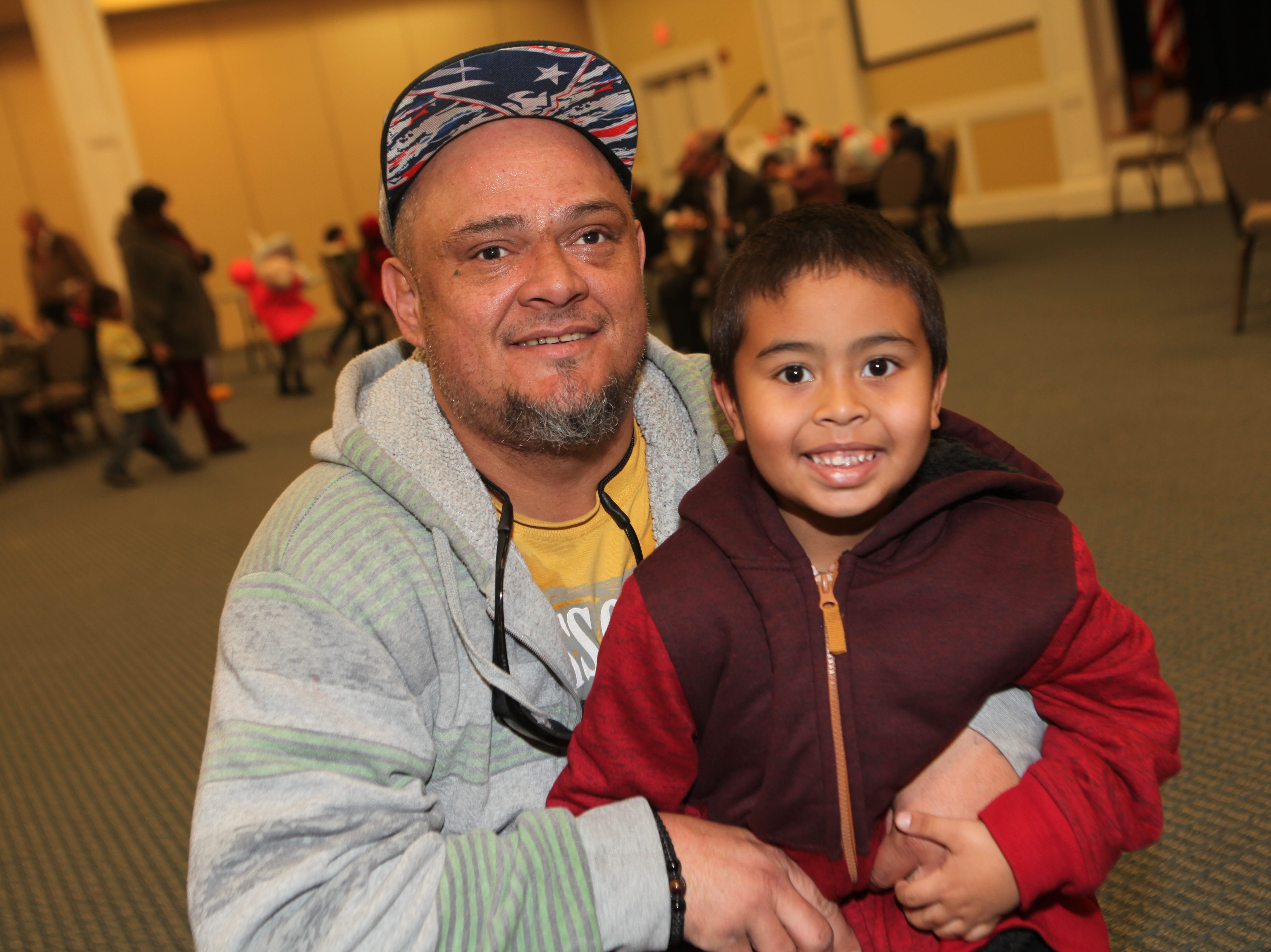 Reuben and Ramon Sanchez smile during the Clarksville Kiwanis Club's annual Christmas Party giving 144 Head Start children a visit with Santa Claus and a bag full of early Christmas presents, Dec. 4, 2018 in Clarksville, Tenn.