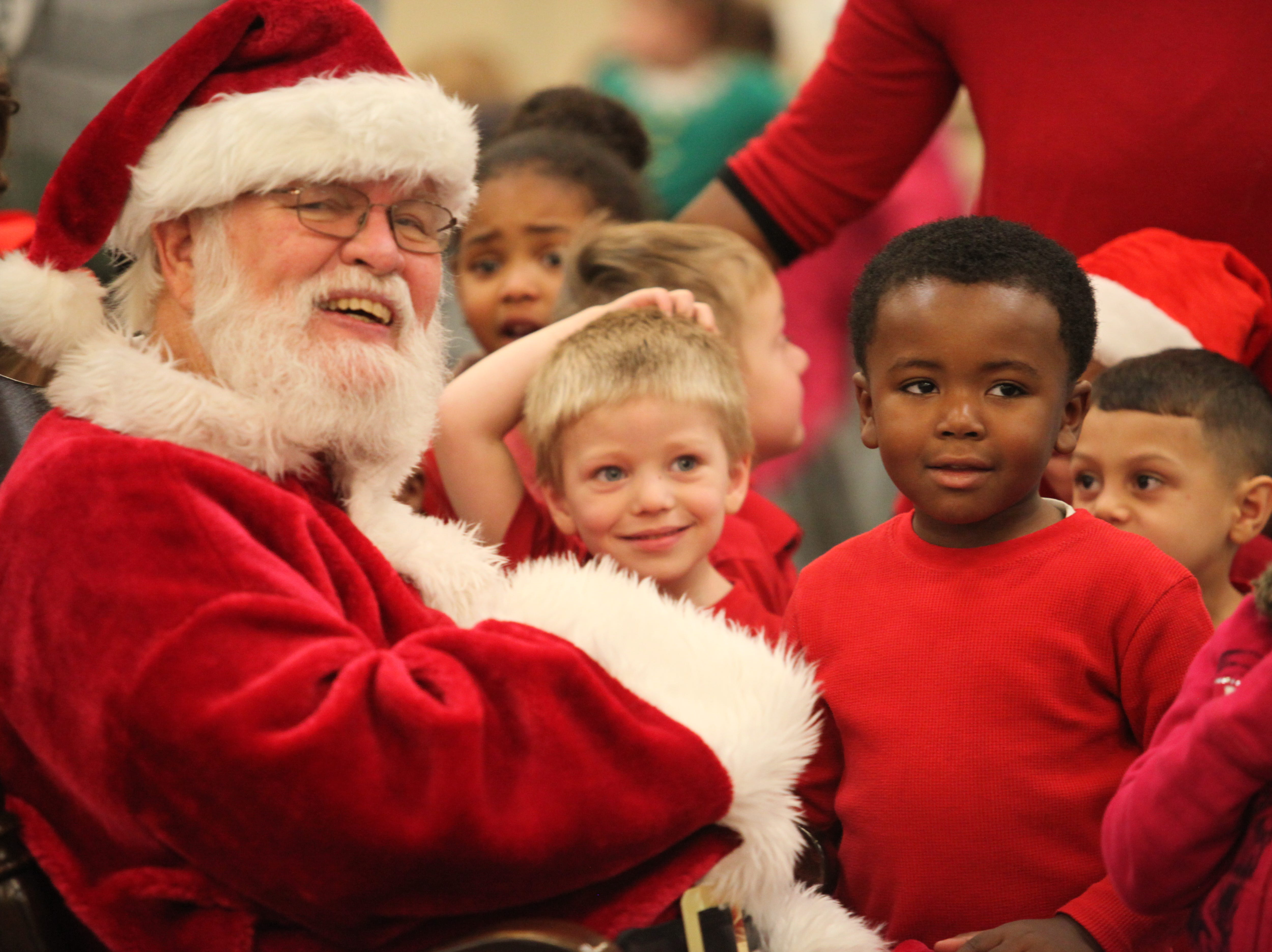 Santa visits with kids during the Clarksville Kiwanis Club's annual Christmas Party giving 144 Head Start children a visit with Santa Claus and a bag full of early Christmas presents, Dec. 4, 2018 in Clarksville, Tenn.