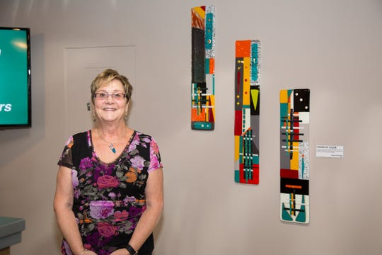 Bethlehem glass fusion artist Rebecca Shoemaker with some of her artwork purchased by Unity Bank through a program to support local artists.