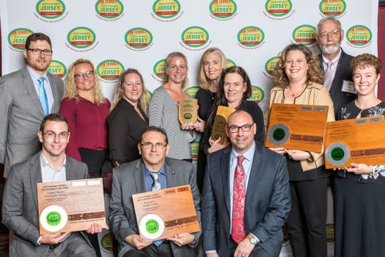 Left to right (top row): Sustainable Jersey Executive Director; Randall Solomon, Readington Board President; Laura Simon, Board Members; Robyn Mikaelian, Carol Hample, TBS Teachers; Tiffany Barca, Anne Romano, TBS Principal; Kristen Higgins, Sustainable Jersey Chair; Richard Dovey, Energy Coordinator; Jodi Bettermann. (bottom row): Business Administrator; Jason Bohm, Facilities Manager; Don Race, and Superintendent, Dr. Jonathan Hart.