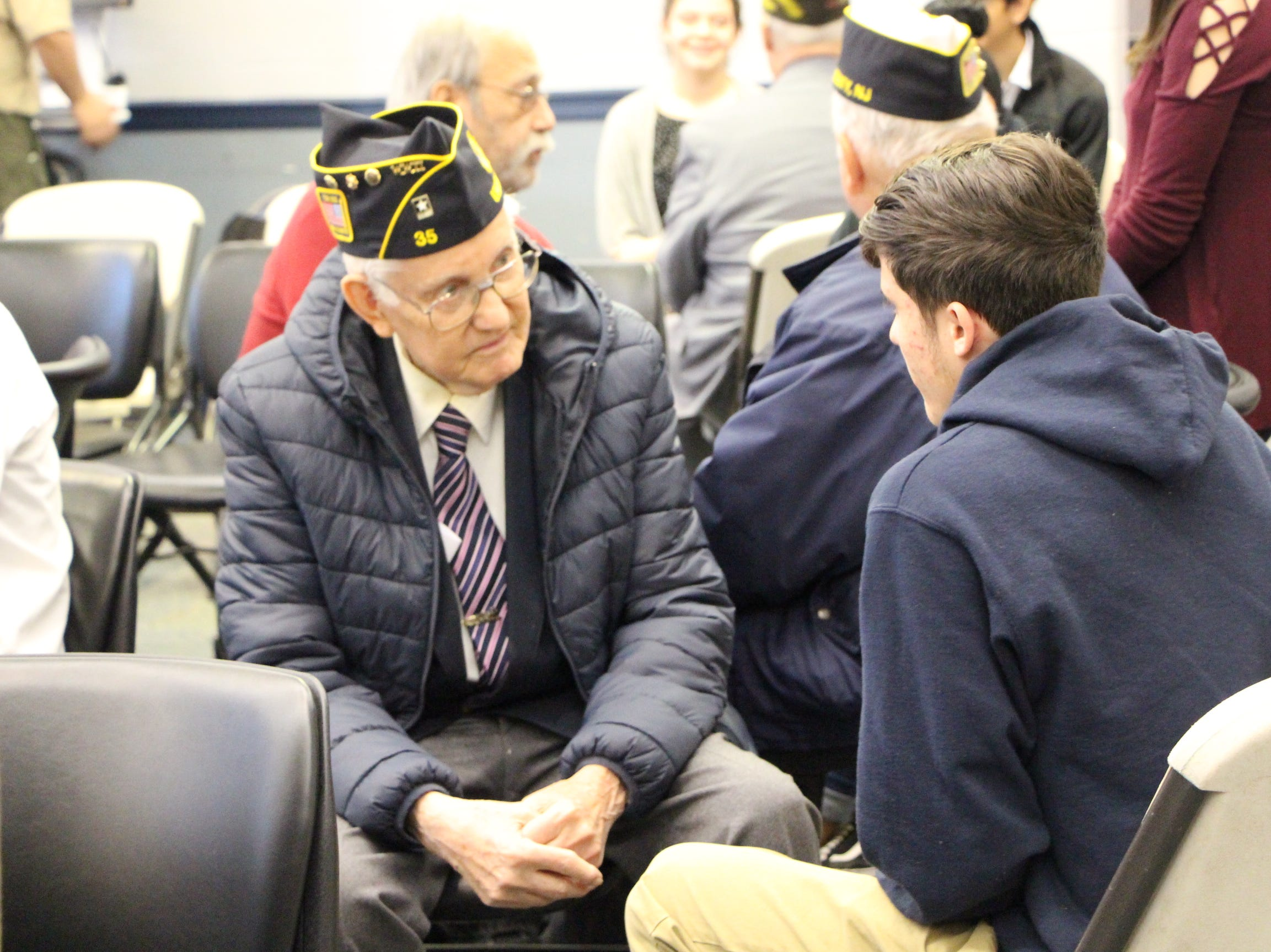 Students and veterans interact during the An Attitude of Gratitude event.