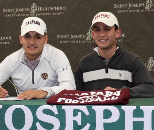 Michael Sot, right, pictured with his brother, Jon, during a National Letter of Intent Signing Day ceremony at St. Joseph High School.